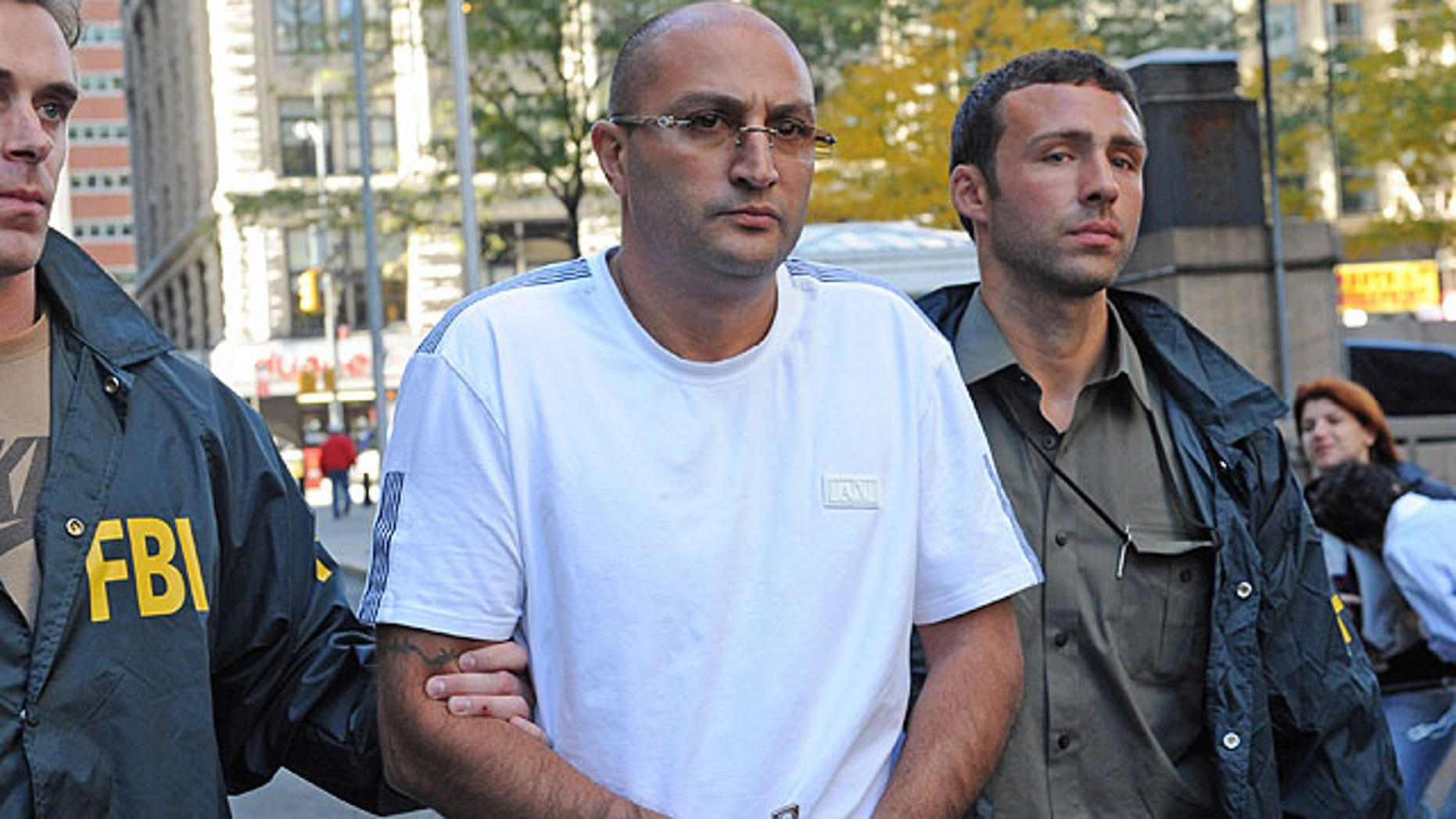 Oct, 13, 2010: Robert Terdjanian  is led in handcuffs from FBI headquarters in New York. Dozens of people on both coasts have been charged by Manhattan prosecutors in a $100 million Medicare fraud scheme.