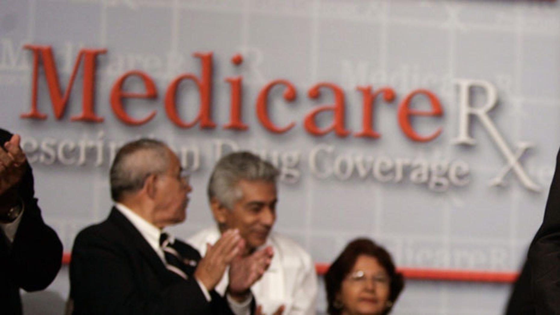FILE: Attendees of a 2006 conversation on the Medicare Prescription Drug Benefit at the Asociacion Borinquena de Florida Central in Orlando, Fla.