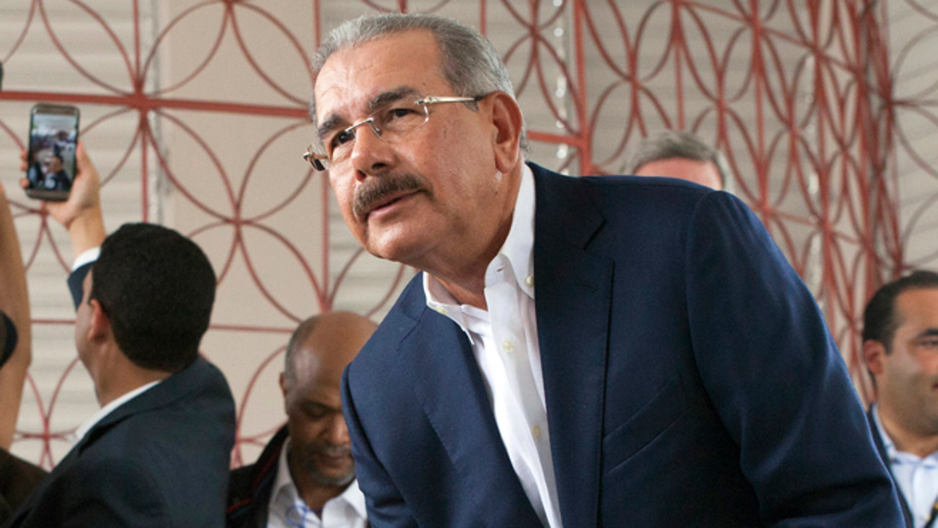 Danilo Medina casts his ballot during the general elections in Santo Domingo, Sunday, May 15, 2016.