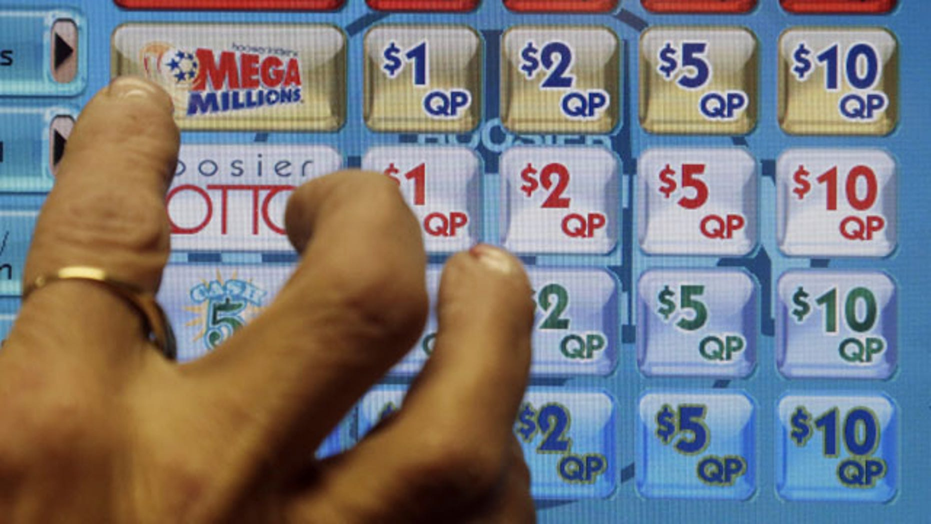December 17, 2013: A clerk prepares to operate a lottery machine to print out Mega Millions lottery tickets for a customer in Muncie, Ind. The March 18, 2014 estimated $400 million Mega Millions jackpot could potentially be the sixth-largest in lottery prize in U.S. history. (AP Photo/Darron Cummings, File)