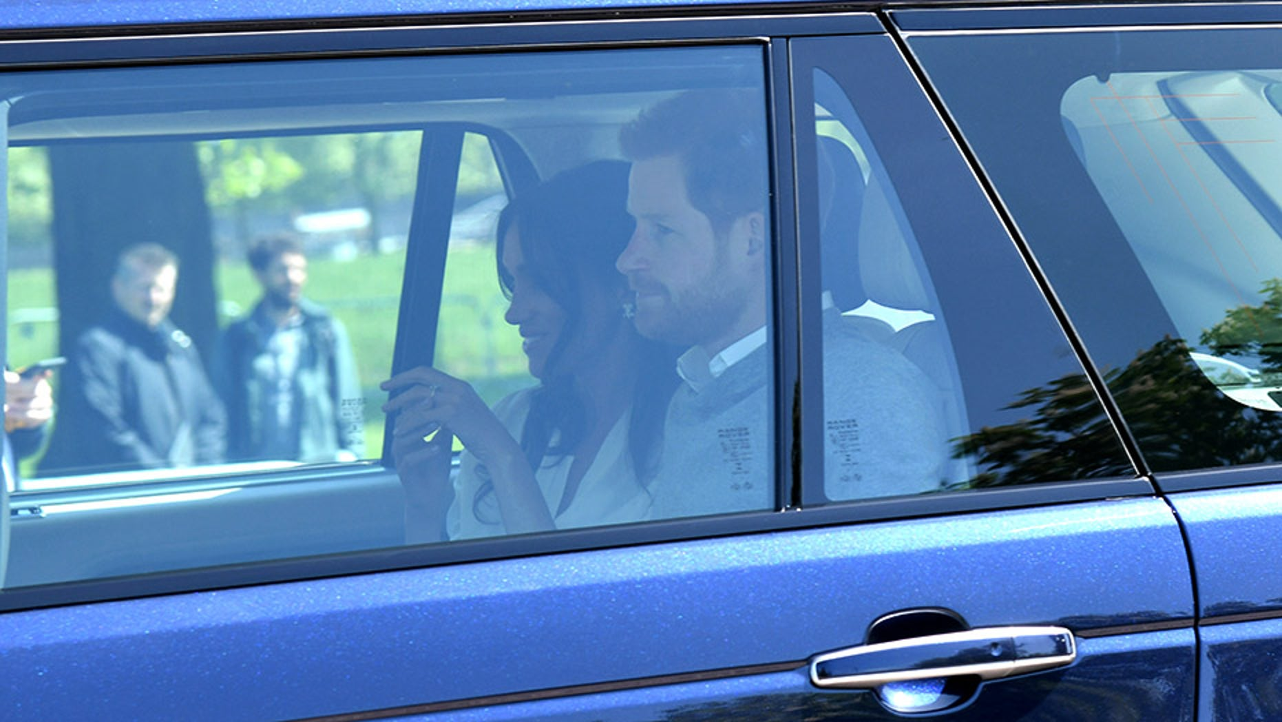 Meghan Markle wore $10,000 earrings and white blouse upon arrival in Windsor for the royal wedding rehearsal.
