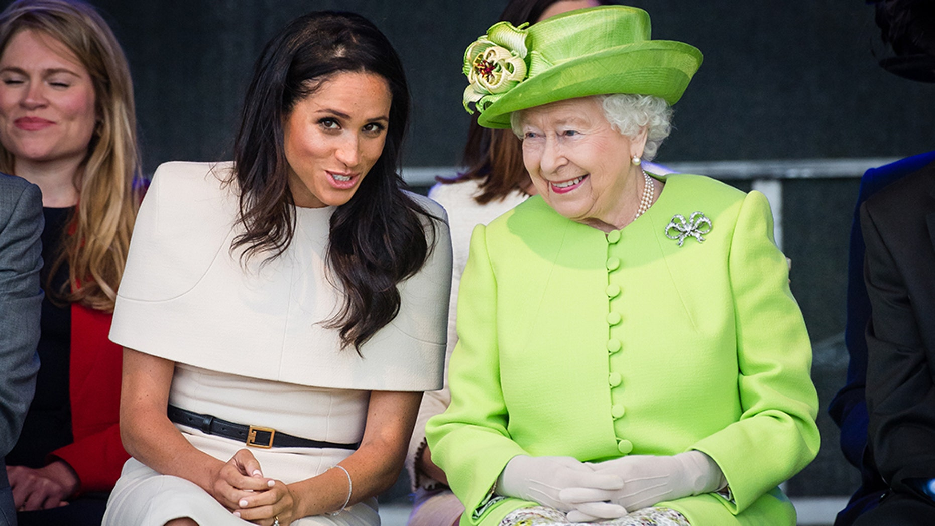 The Queen reportedly gifted Markle a pair of pearl earrings to match her own beloved pair.
