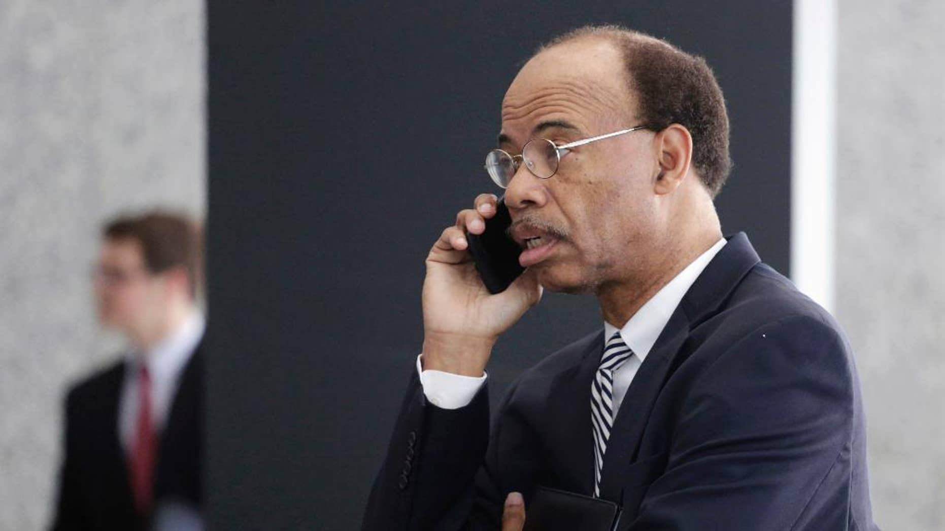 Former Illinois Congressman Mel Reynolds talks on his cell phone as he leaves federal court in Chicago, Thursday, July 30, 2015, after pleading not guilty to federal tax charges. Reynolds, with no home of his own, is scrambling to find a place to stay after prosecutors told the hearing that restrictions on sexual offenders should apply to the Chicago Democrat. Reynold's resigned from Congress in 1995 after being convicted of statutory rape. The housing issues arose when the hearing moved to questions about bond. (AP Photo/M. Spencer Green)