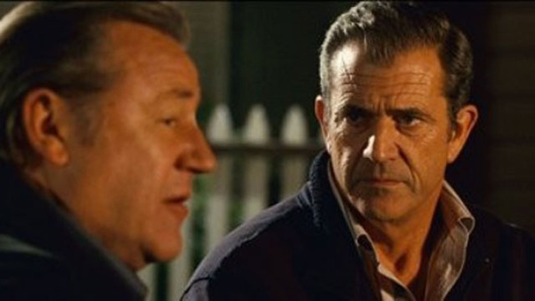 In this film publicity image released by Warner Bros.,Ray Winstone, left, and Mel Gibson are shown in a scene from, 'Edge of Darkness.'
