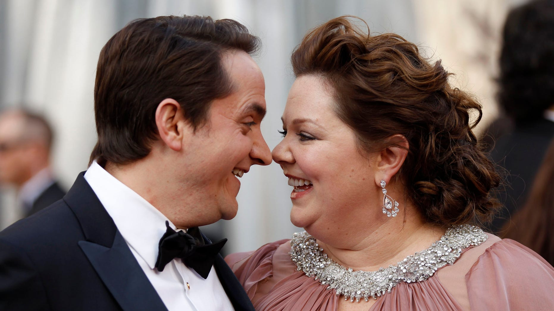 "Melissa McCarthy, best supporting actress nominee for her role in ""Bridesmaids,"" and her husband, Ben Falcone, arrive at the 84th Academy Awards in Hollywood, California, February 26, 2012.  REUTERS/Lucy Nicholson  (UNITED STATES) (OSCARS-ARRIVALS)"