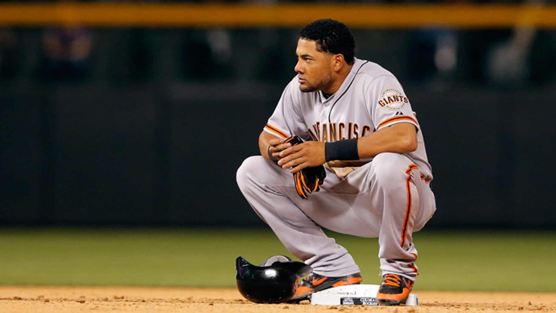 DENVER, CO - AUGUST 03:  Melky Cabrera #53 of the San Francisco Giants pauses at second base after doubling against the Colorado Rockies at Coors Field on August 3, 2012 in Denver, Colorado. The Giants defeated the Rockies 16-4.  (Photo by Doug Pensinger/Getty Images)