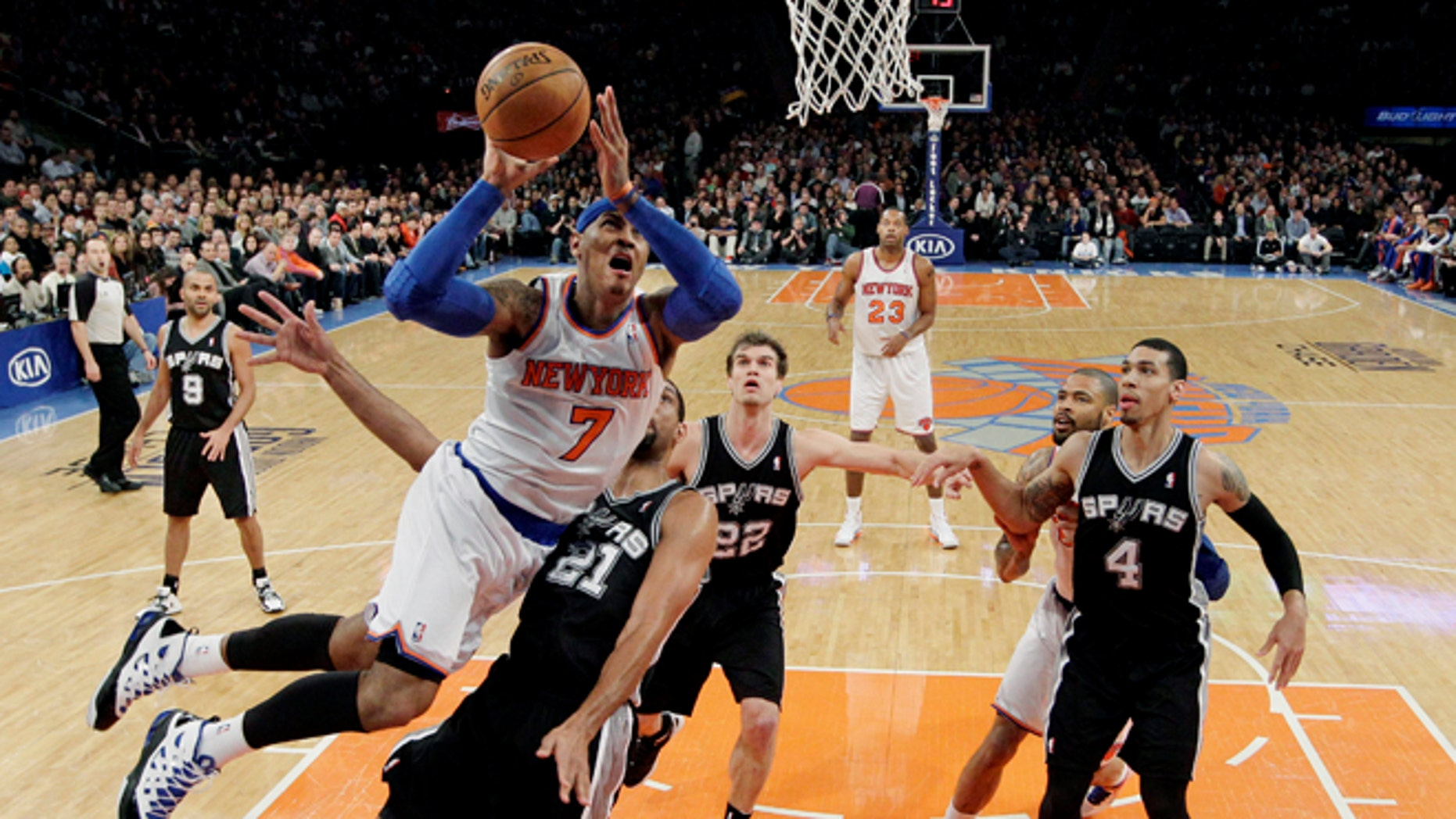 New York Knicks forward Carmelo Anthony (7) shoots a layup against San Antonio Spurs forward Tim Duncan (21) as guard Tony Parker (9), forward Tiago Splitter (22) and guard Danny Green (4) watch in the first half of their NBA basketball game at Madison Square Garden in New York, Thursday, Jan. 3, 2013. Anthony scored 23 points as the Knicks won 100-83. (AP Photo/Kathy Willens)