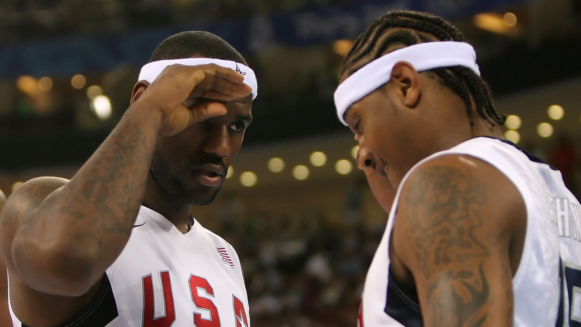 BEIJING - AUGUST 20:  Lebron James #6 and Carmelo Anthony #15 of the United States salute one another before the men's basketball quarterfinal game against Australia at the Olympic Basketball Gymnasium during Day 12 of the Beijing 2008 Olympic Games on August 20, 2008 in Beijing, China.  (Photo by Streeter Lecka/Getty Images)