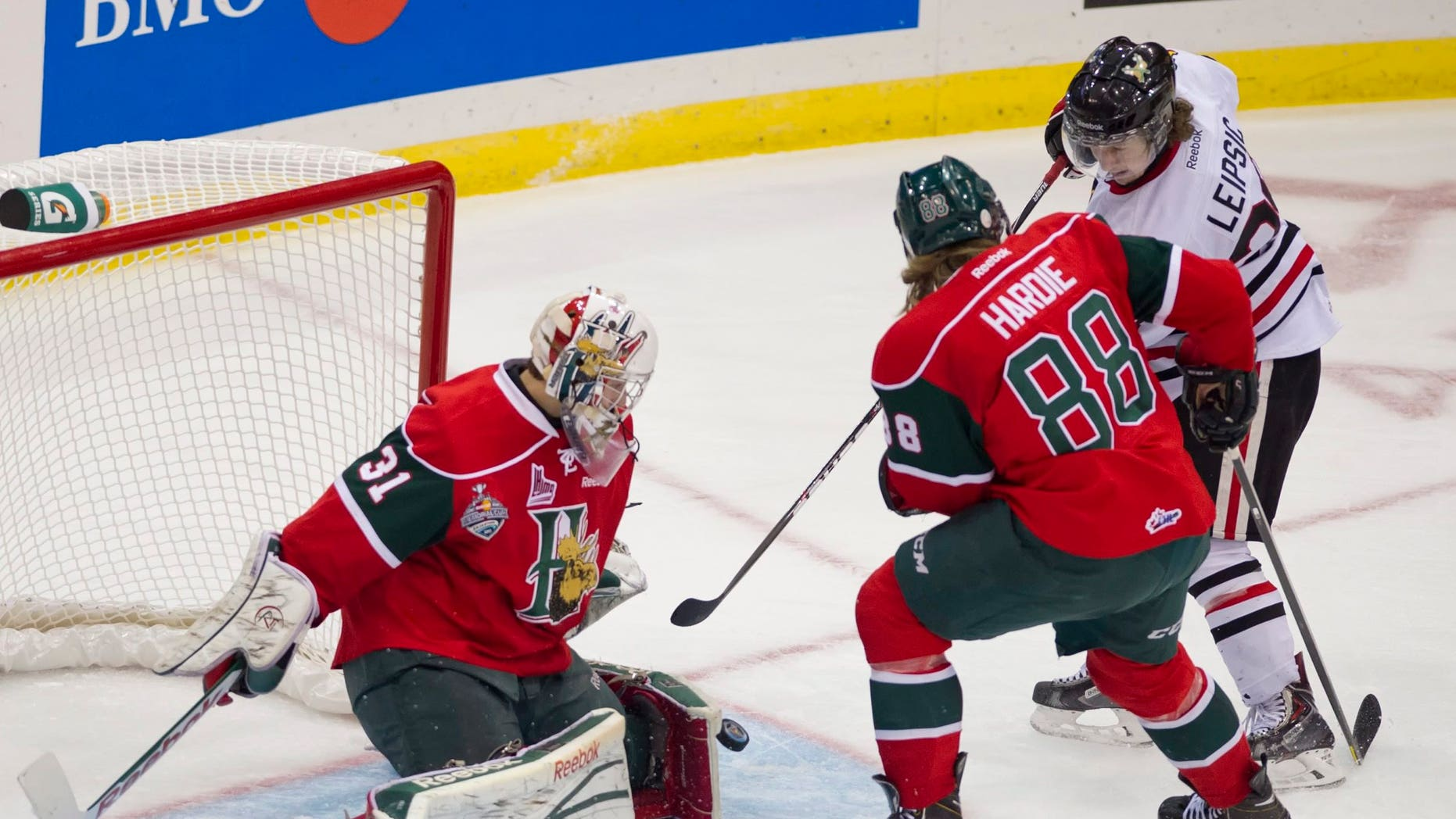 Halifax Mooseheads goaltender Zachary Fucale turns away a shot with the help of defenseman Austyn Hardie as Portland Winterhawks center Brendan Leipsic presses sduring the first period of a junior hockey Memorial Cup game Saturday, May 18, 2013, in Saskatoon, Saskatchewan. (AP Photo/The Canadian Press, Liam Richards)