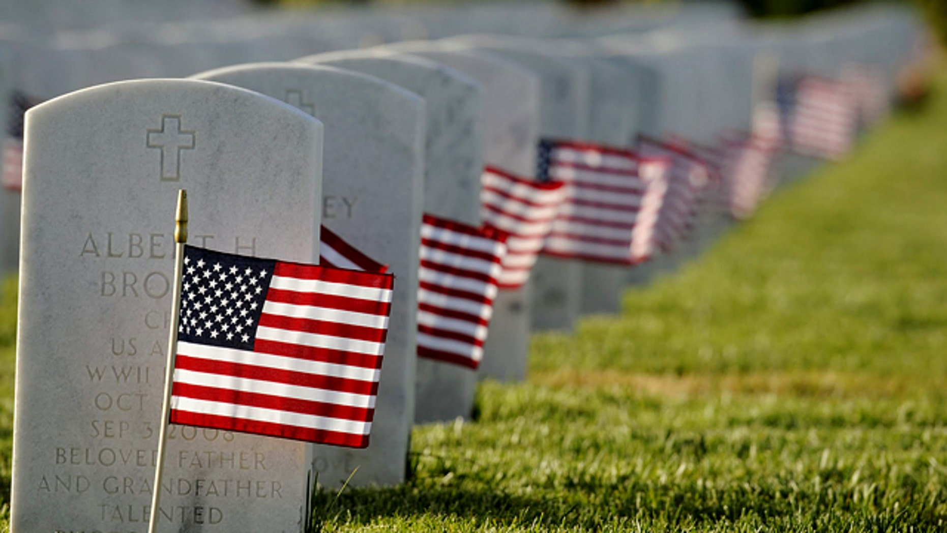 Members of several service organizations including Boy Scouts, Girl Scouts, 4-H and private citizens fanned out across the 561-acre Sacramento Valley National Cemetery in Dixon, Calif. to make sure every one of the grave nearly six thousand armed service members buried received a flag the on Thursday, May 27, 2010 in preparation for Monday's Memorial Day Service at the VA Cemetery.(AP Photo/The Reporter, Joel Rosenbaum) MANDATORY CREDIT; MAGS OUT; NO SALES