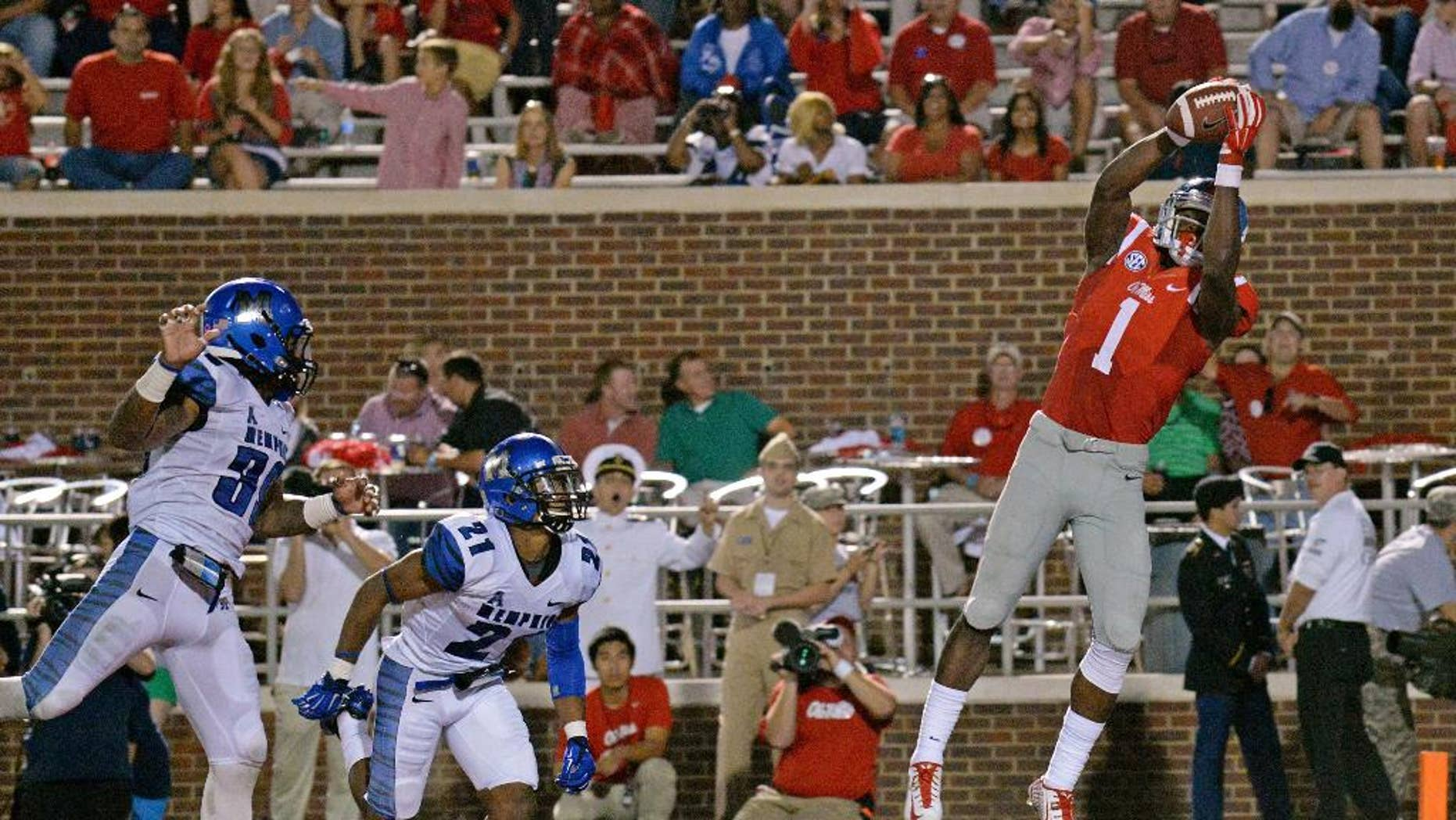 Mississippi wide receiver Laquon Treadwell (1) catches a touchdown pass as Memphis defensive backs Reggis Ball (39) and Bobby McCain (21) watch during the second half of an NCAA college football game in Oxford, Miss., Saturday, Sept. 27, 2014. No. 10 Mississippi won 24-3. (AP Photo/The Daily Mississippian, Thomas Graning)