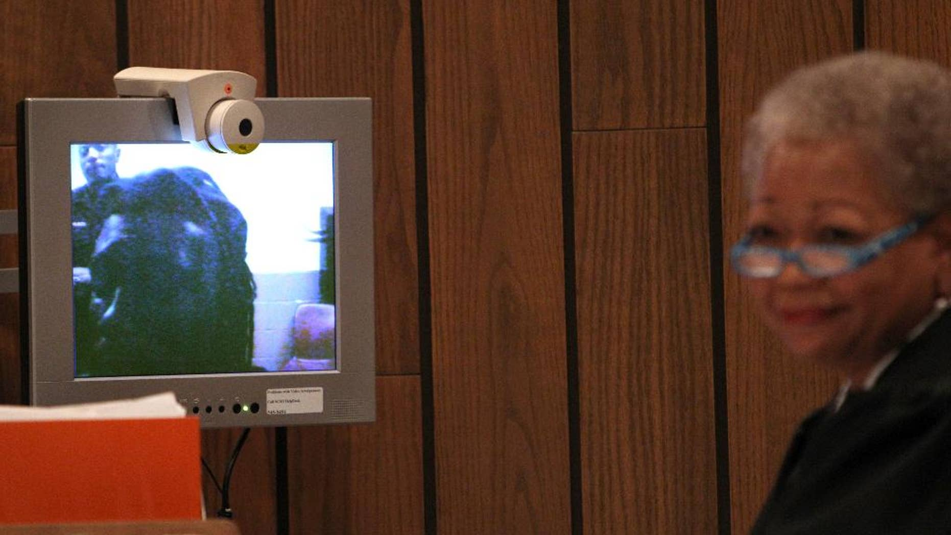 Defendant Tremaine Wilbourn appears before Judge Loyce Lambert Ryan via video arraignment Wednesday, Aug. 5, 2015, in general session court Division 15 on charges of first degree murder for the death of Memphis police Officer Sean Bolton. Wilbourn did not enter a plea on the charge of first-degree murder. (Mike Brown/The Commercial Appeal via AP)