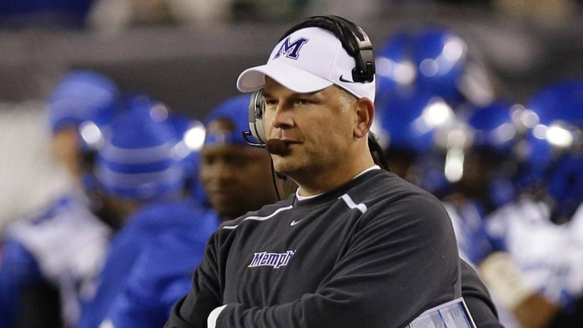 FILE -- In this Oct. 4, 2014, file photo, Memphis coach Justin Fuente watches from the sideline in the first half of an NCAA college football game against Cincinnati in Cincinnati. Fuente said he saw plenty of potential in Memphis when he was hired to take over the program in December 2011. Now, his faith is being rewarded as Memphis could clinch at least a share of the American Athletic Conference title with a victory Saturday against Connecticut. (AP Photo/Al Behrman, File)