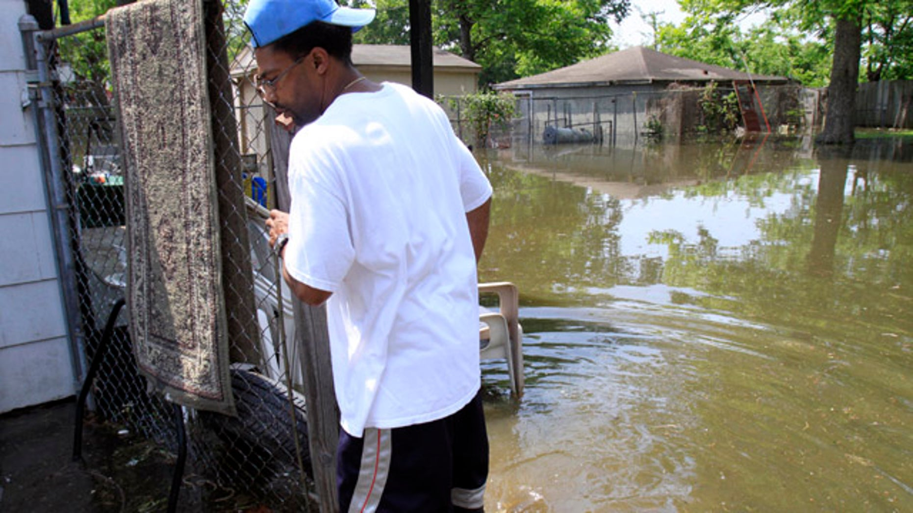 May 8: Gary Dugger walks in his flooded backyard in Memphis, Tenn. Dugger was hoping to wait out the flood in his home but rising water has forced him to flee for higher ground as the mighty Mississippi River edged toward the city, threatening to bring more flooding to parts of an area already soaked.