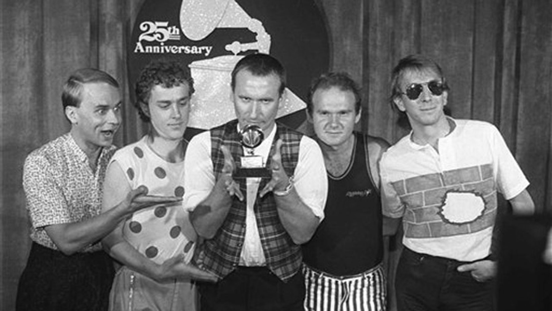 Feb. 22, 1983: In this file photo, members of 'Men at Work' from left, Greg Ham, Ron Strykert, Colin Hay, Jerry Speiser and John Rees, pose with their Grammy for best new artist at the awards show in Los Angeles.