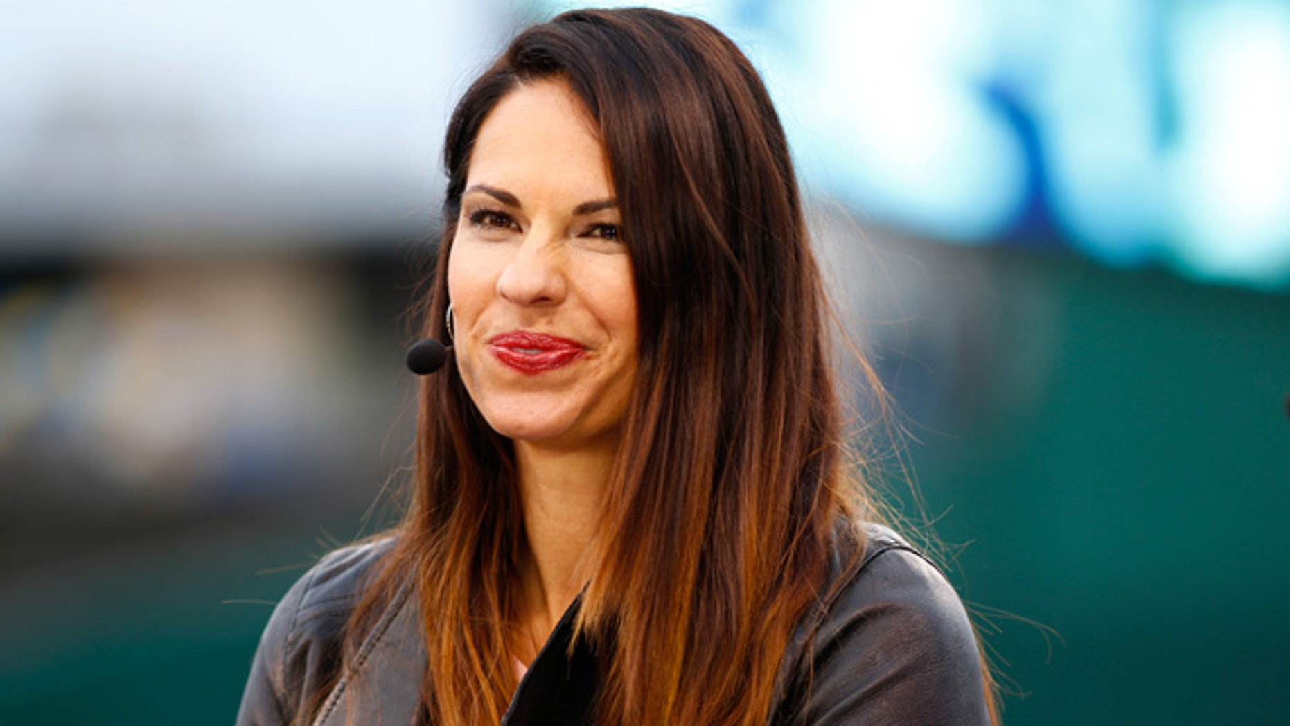 Jessica Mendoza of ESPN speaks on set the day before Game 1 of the 2015 World Series between the Royals and Mets at Kauffman Stadium on October 26, 2015 in Kansas City, Missouri.