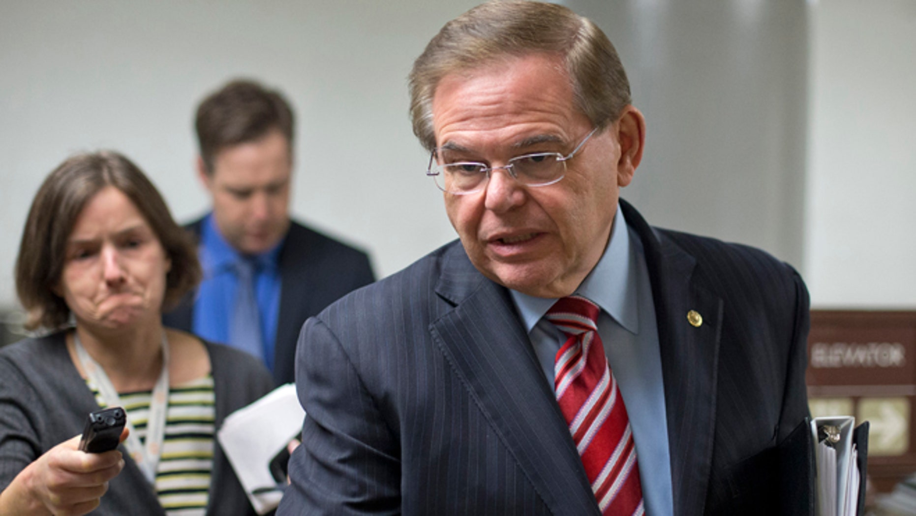 Sen. Bob Menendez, D-N.J., rushes through the Capitol on the way to the Senate Foreign Relations Committee, where he is taking over as chairman, replacing John Kerry, the new secretary of state, Wednesday, Feb. 13, 2013, on Capitol hill in Washington.  (AP Photo/J. Scott Applewhite)