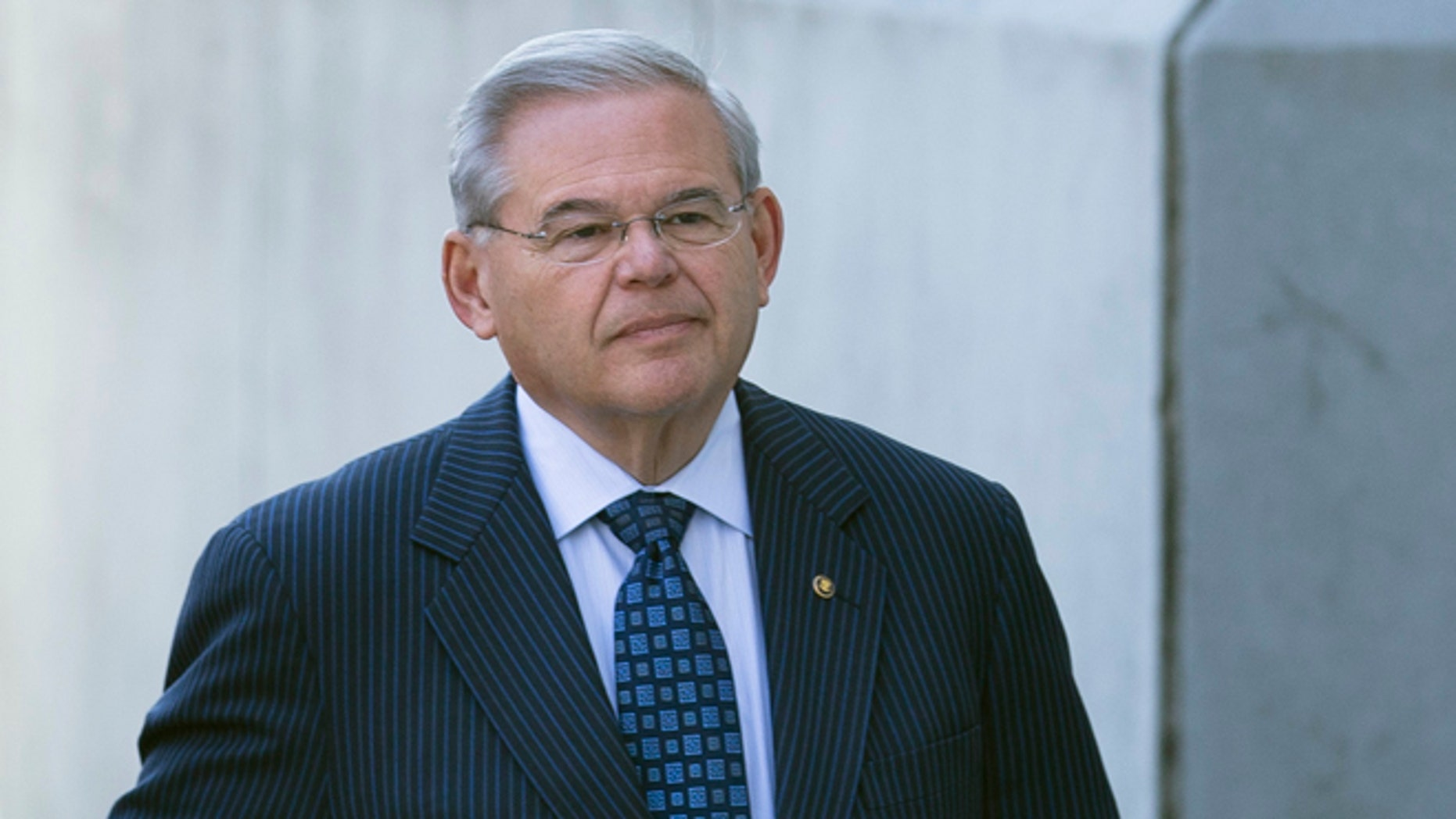 U.S. Sen. Bob Menendez arrives at Newark federal court, Thursday, April 2, 2015, in Newark, N.J. Menendez, the top Democrat on the U.S. Senate Foreign Relations Committee, was indicted Wednesday on corruption charges. A federal grand jury indictment accuses Menendez of using the power of his Senate seat to benefit Salomon Melgen, a wealthy Florida eye doctor who prosecutors say provided the senator with luxury vacations, airline travel, golf trips and tens of thousands of dollars in contributions to a legal defense fund. (AP Photo/John Minchillo)