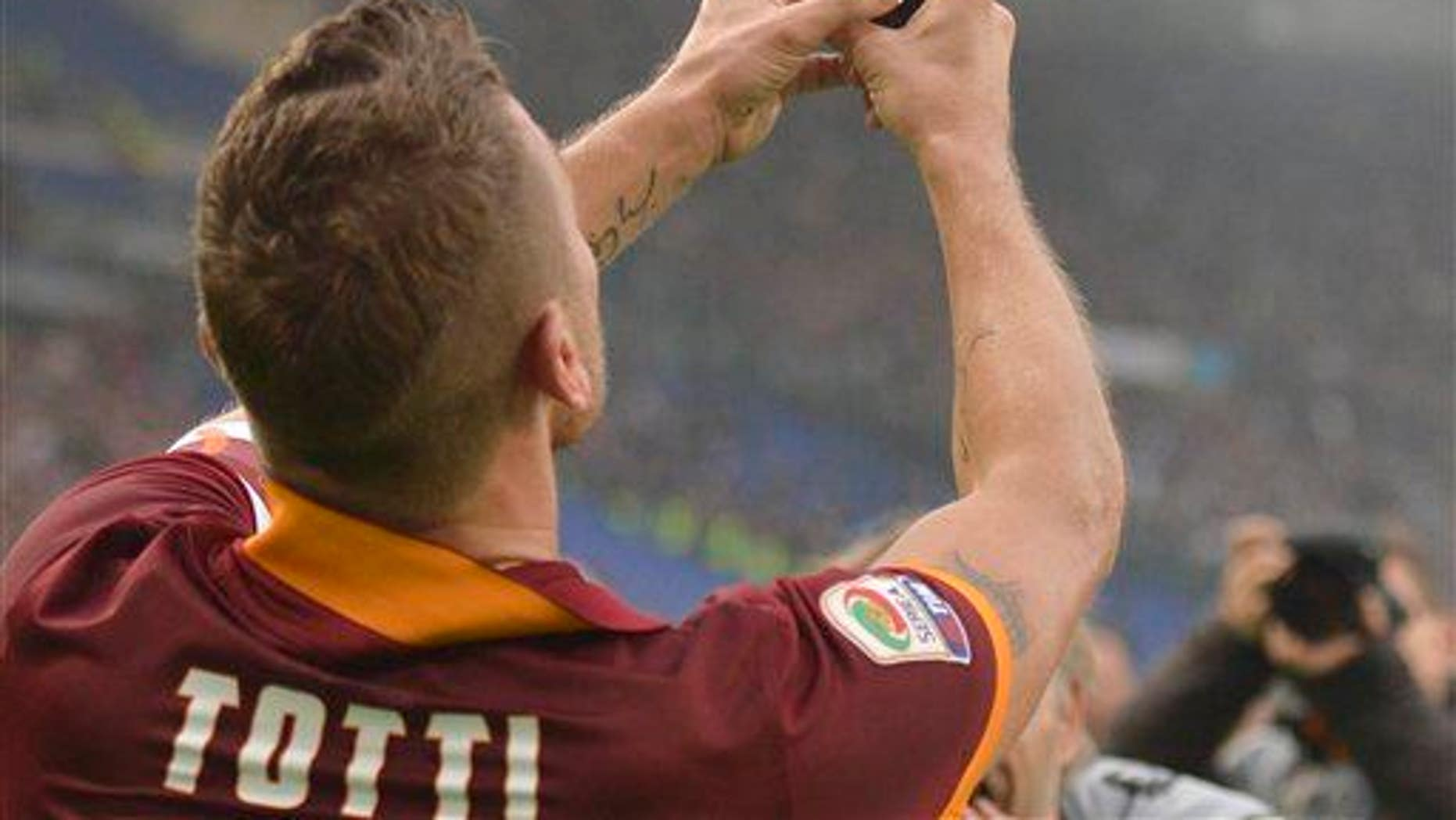 Roma's Francesco Totti takes a selfie after scoring during a Serie A soccer match between Roma and Lazio.