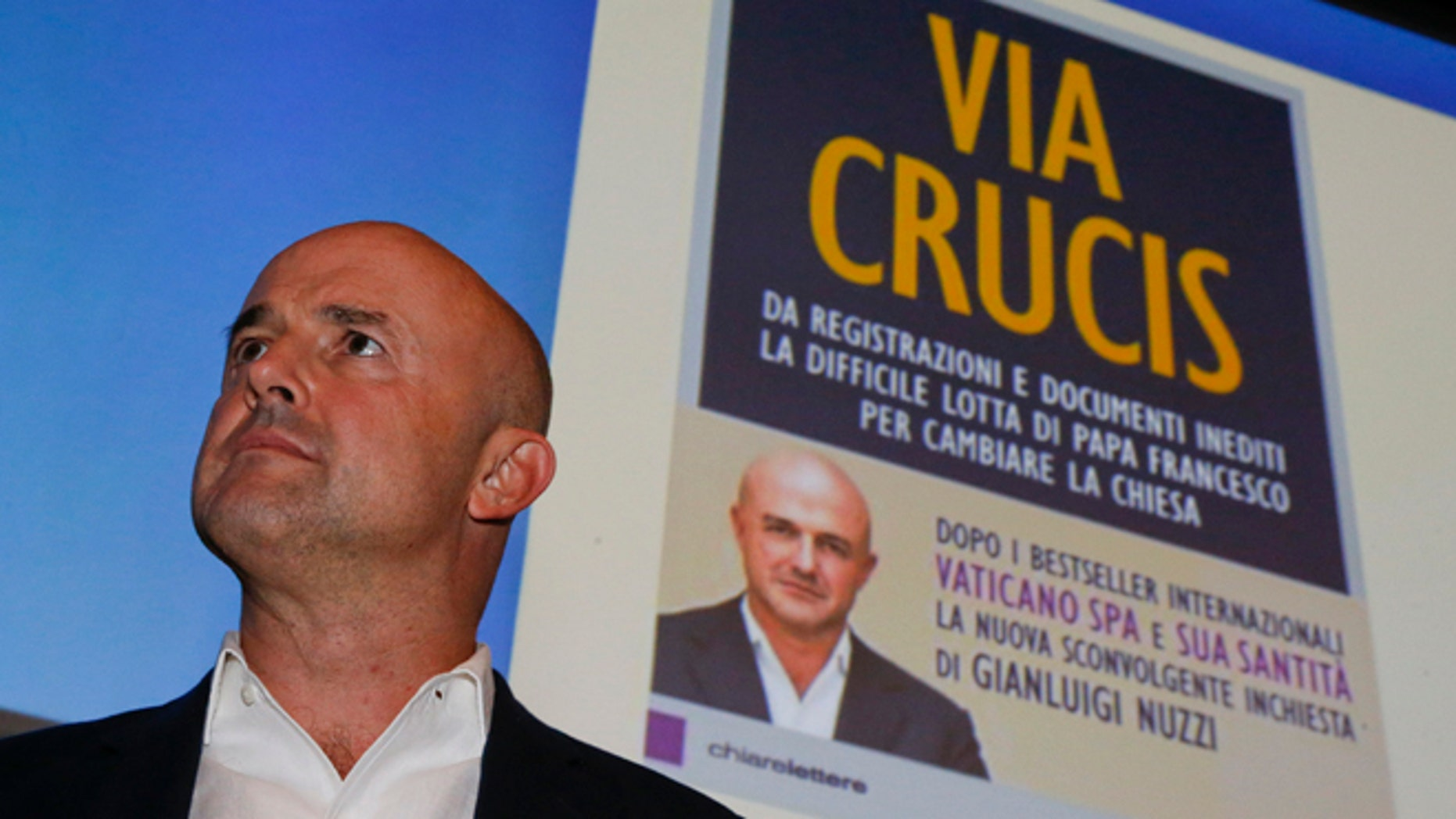 """Italian journalist and writer Gianluigi Nuzzi attends a press conference to promote the release of his new book ''Via Crucis'' (""""Merchants in the Temple"""", in the English language edition) in Milan, Italy, Monday, Nov. 16 2015. In his book Nuzzi makes some startling allegations, including a report that Vatican """"postulators"""" - officials who promote sainthood causes - bring in hundreds of thousands of euros in donations for their causes but are subject to no oversight as to how the money is spent. (AP Photo/Luca Bruno)"""
