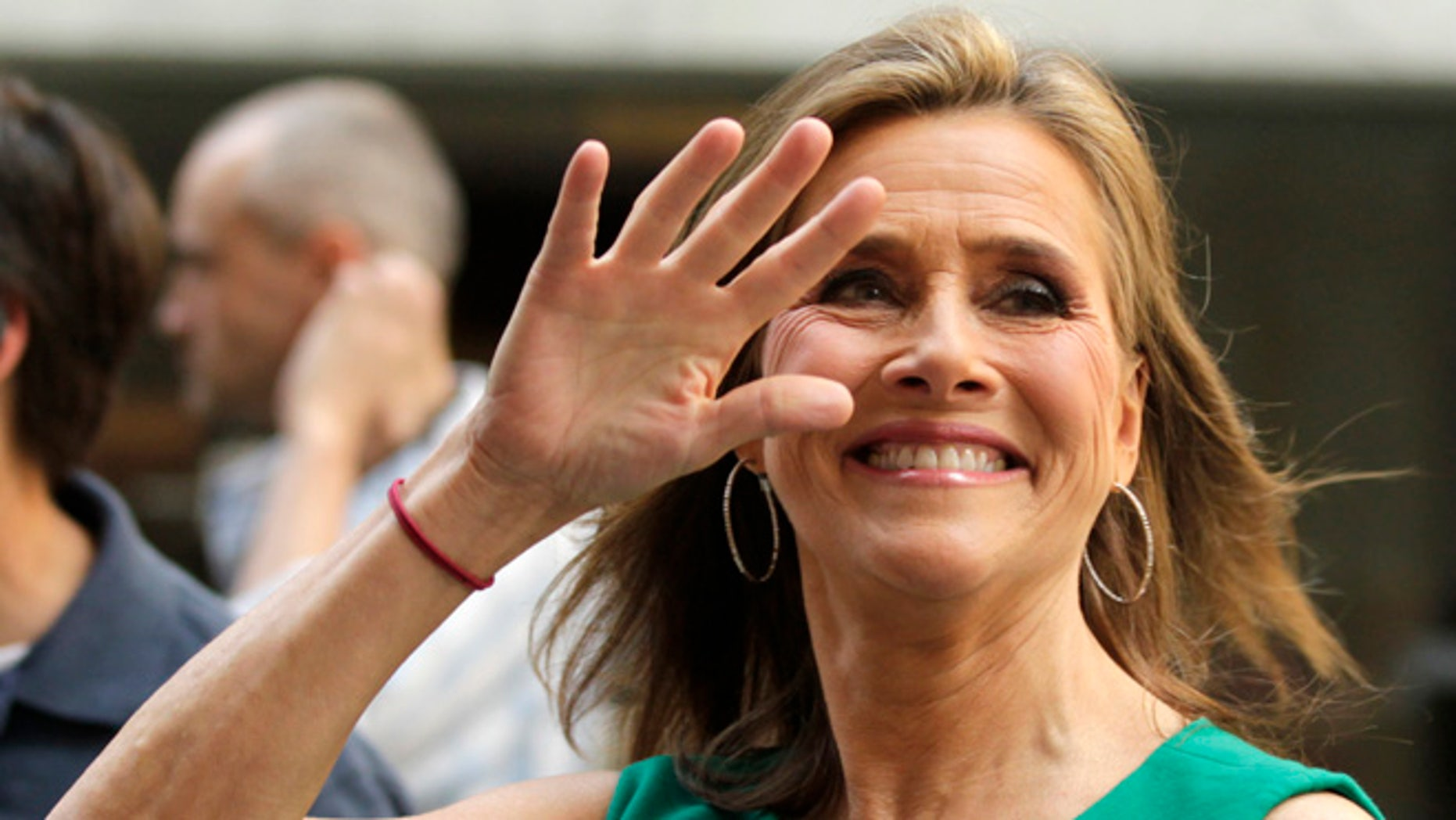 "June 8, 2011. Meredith Vieira waves to fans during her final ""Today"" show in New York, June 8, 2011."