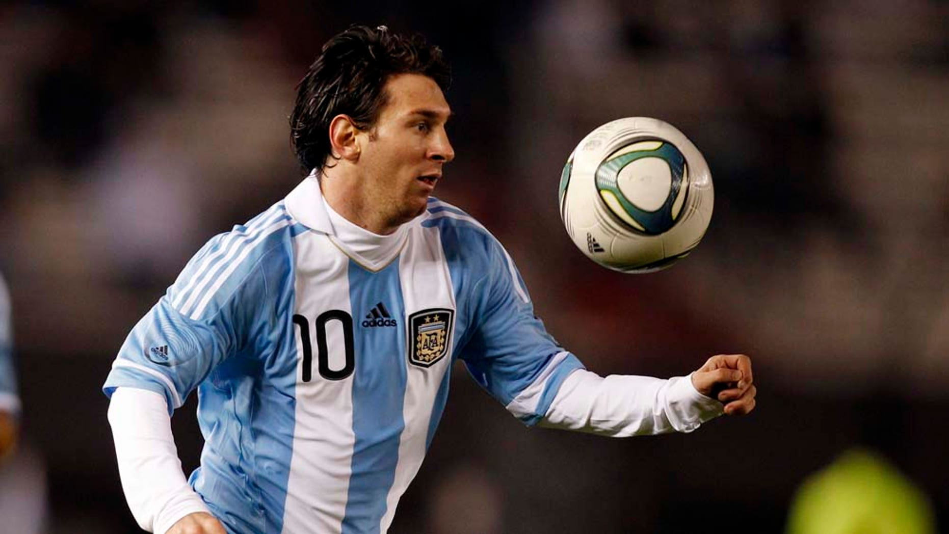 Argentina's Lionel Messi keeps his eye on the ball at a friendly soccer match with Albania ahead of the upcoming 2011 Copa America in Buenos Aires, Argentina, Monday June 20, 2011. (AP Photo/Natacha Pisarenko)