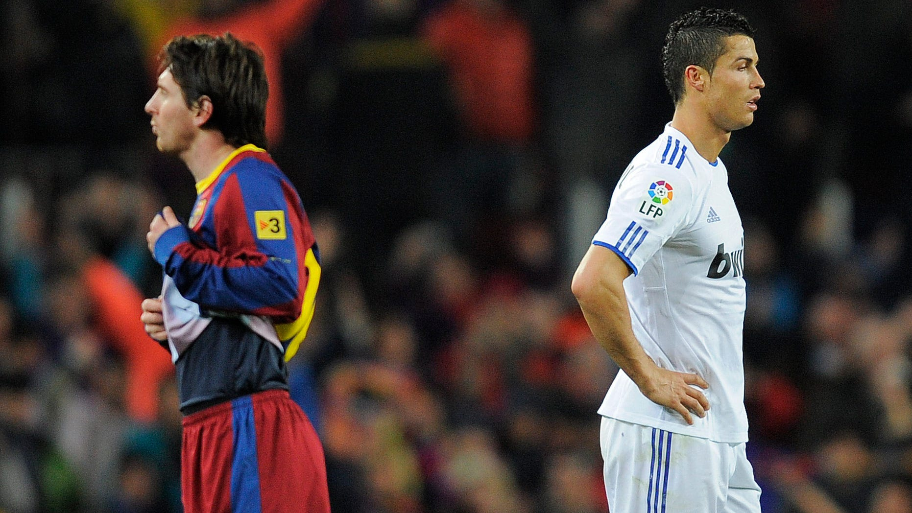 Cristiano Ronaldo of Real Madrid (R) and Lionel Messi of FC Barcelona look on during the La Liga match between Barcelona and Real Madrid at the Camp Nou Stadium on November 29, 2010 in Barcelona, Spain.