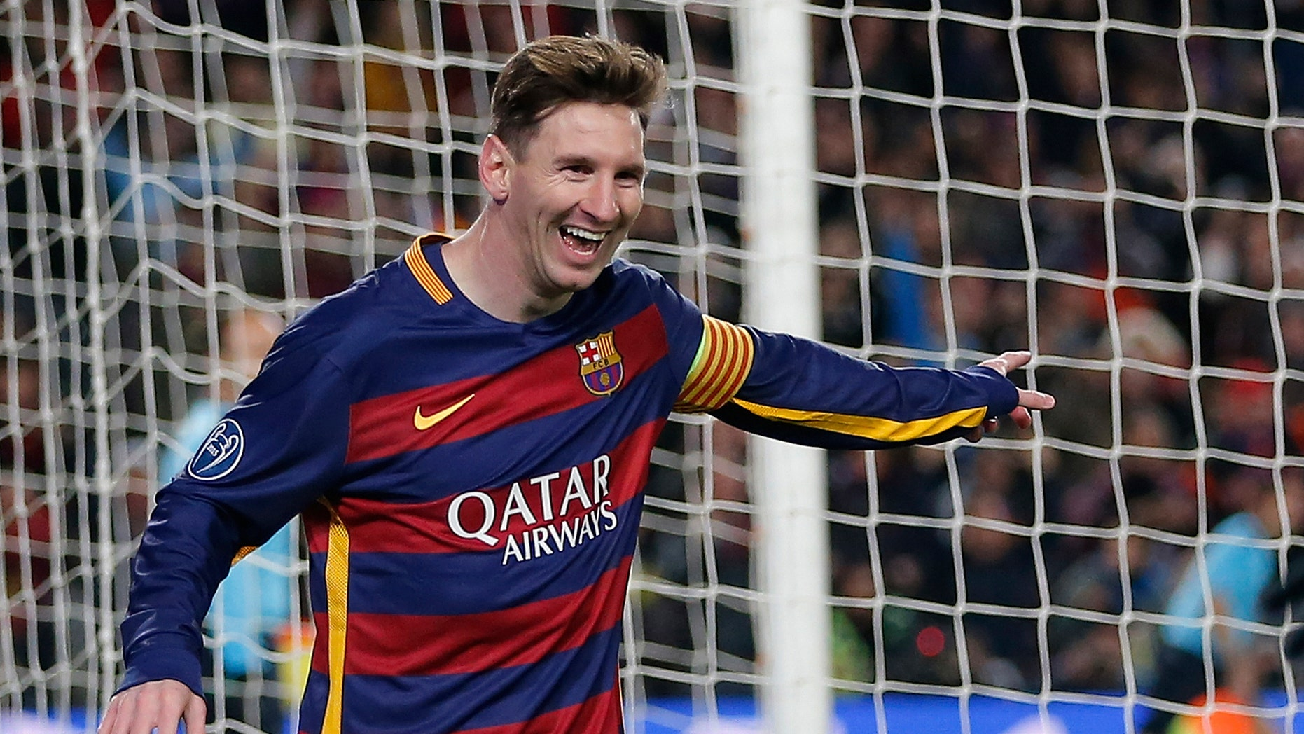 Barcelona's Lionel Messi, left, celebrates after scoring his team's 5th goal during the Group E Champions League soccer match between Barcelona and Roma at the Camp Nou stadium in Barcelona, Spain, Tuesday Nov. 24, 2015. (AP Photo/Emilio Morenatti)