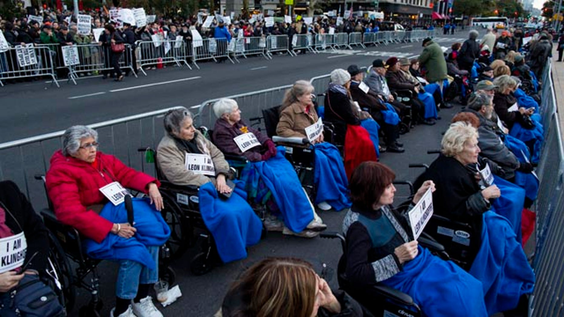 October 20, 2014: A long line of people in wheelchairs gather at Lincoln Center as they protest 'Death of Klinghoffer' in New York. (AP Photo/Craig Ruttle)