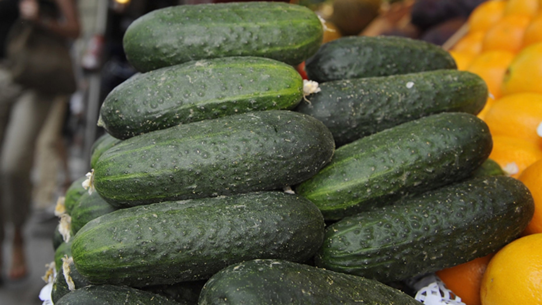 MADRID, SPAIN - JUNE 03: Cucumbers are for sale at San Miguel market on June 3, 2011 in Madrid, Spain. Spaniards continue to buy fresh fruit and vegetables despite the outbreak of E.coli bacteria, also known as EHEC, which is thought to have killed 16 people and left hundreds sick across Europe.  (Photo by Denis Doyle/Getty Images)