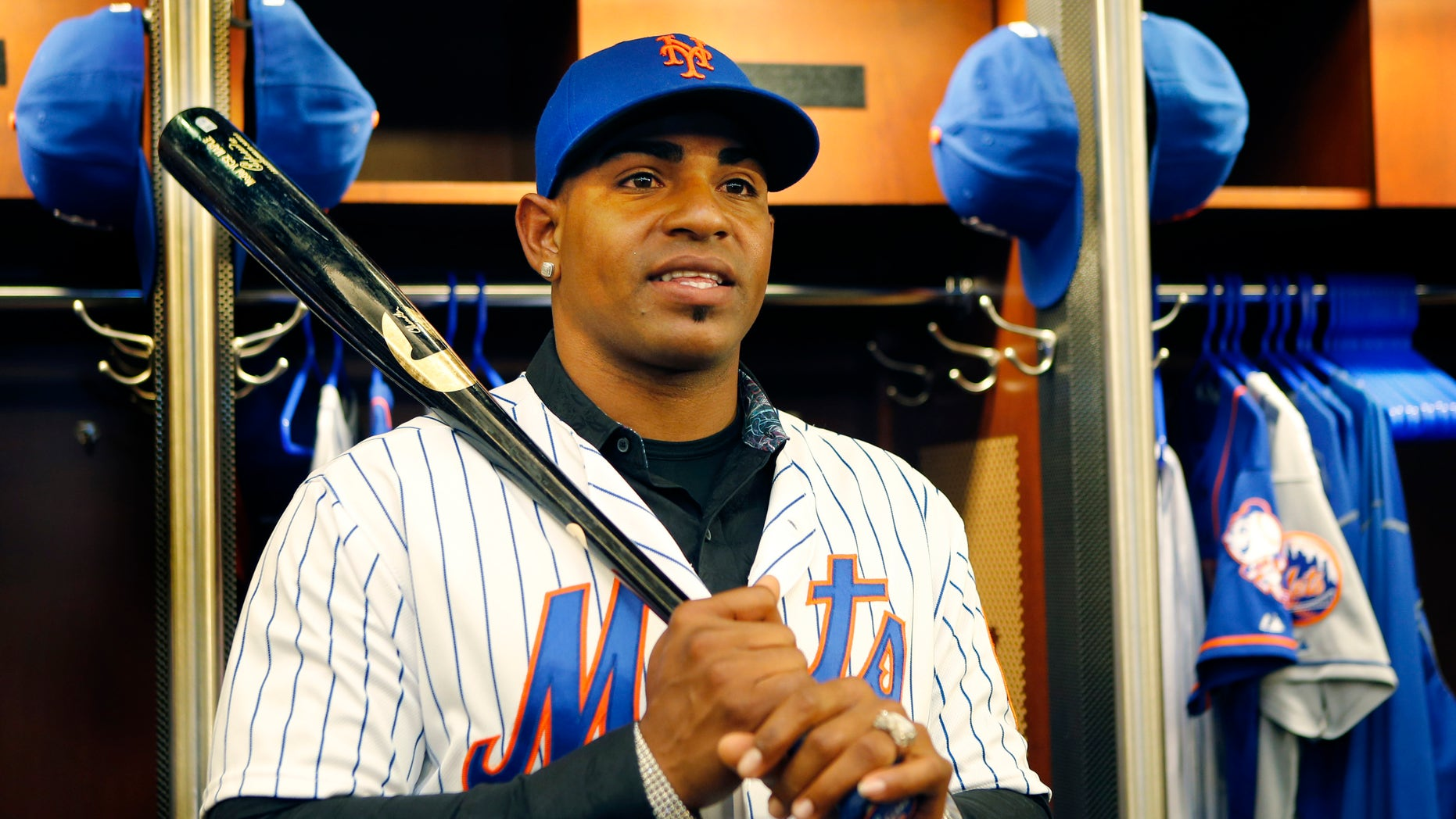 New York Mets Yoenis Cespedes holds a bat as he poses in the clubhouse after a baseball press conference at CitiField in New York, Wednesday, Feb. 3, 2016. Cespedes agreed to a $75 million, three-year deal with the team. (AP Photo/Kathy Willens)