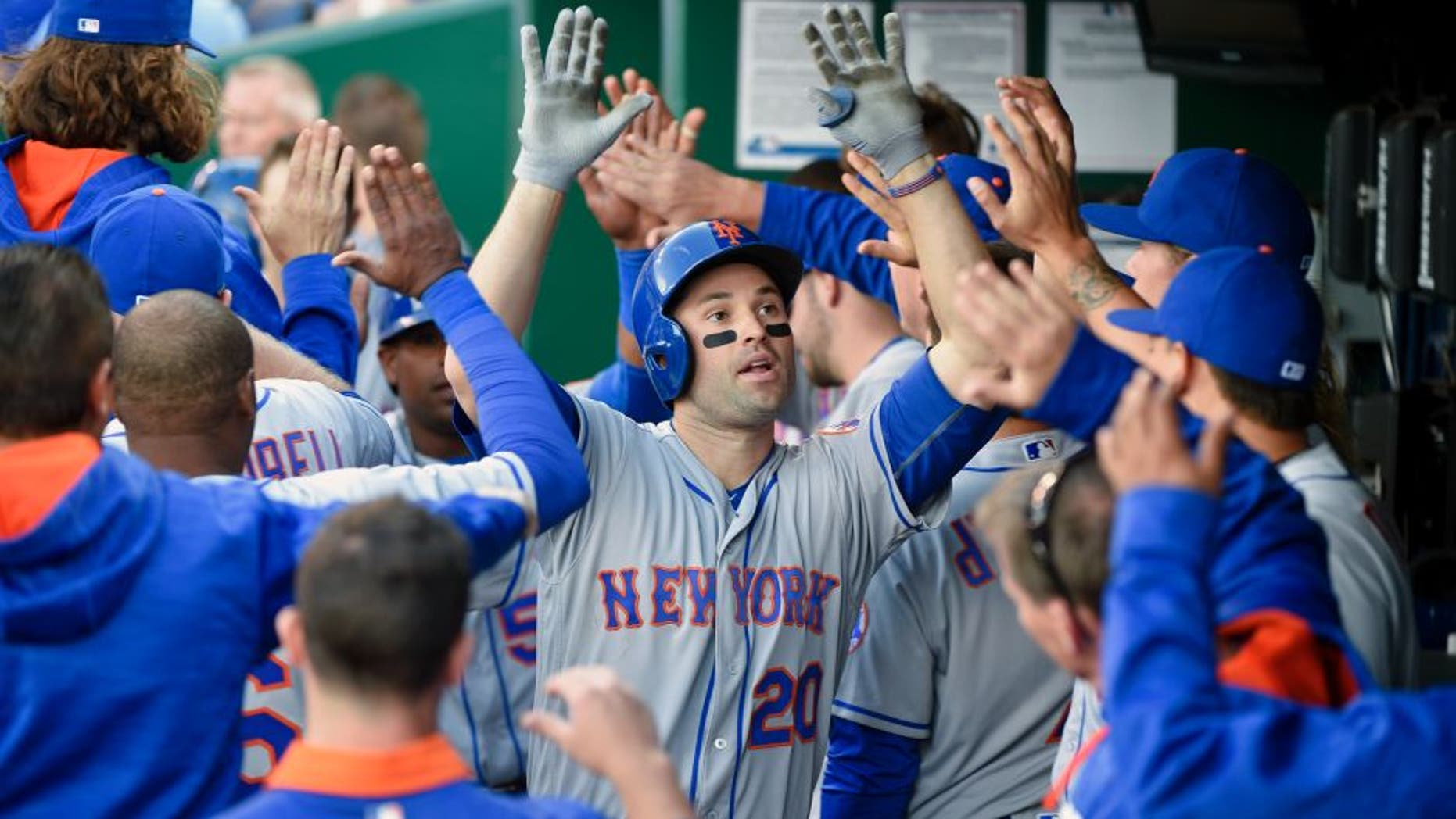 KANSAS CITY, MO - APRIL 5: Neil Walker #20 of the New York Mets celebrates his two-run home run with teammates in the fourth inning during a game against the Kansas City Royals at Kauffman Stadium on April 5, 2016 in Kansas City, Missouri. (Photo by Ed Zurga/Getty Images)