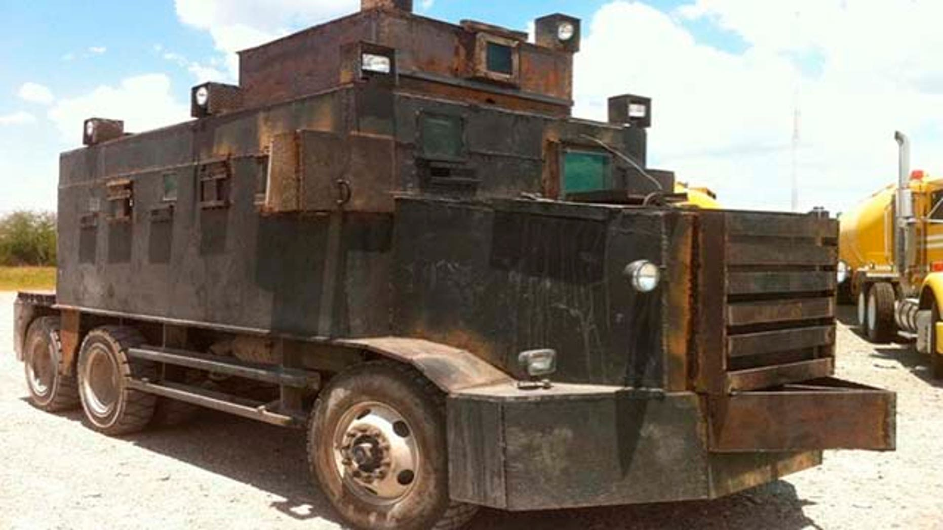 June 5: In this image released by Mexico's Defense Department, a makeshift armored truck is displayed after it was seized on June 4 in the city of Camargo, Mexico. (AP Photo/SEDENA)