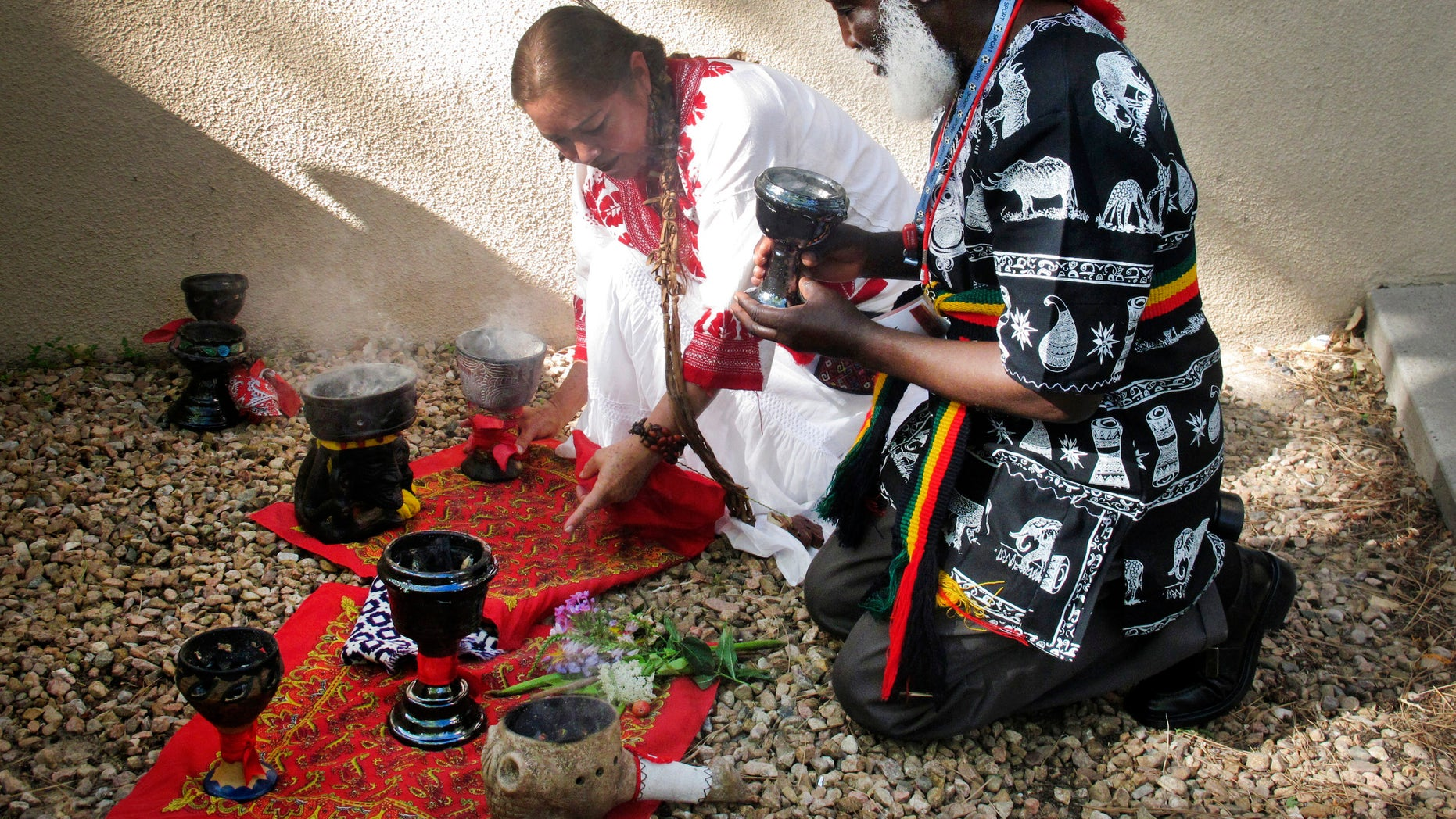 Curanderos, or traditional healers, conducting a ceremony on the campus of the University of New Mexico in Albuquerque.