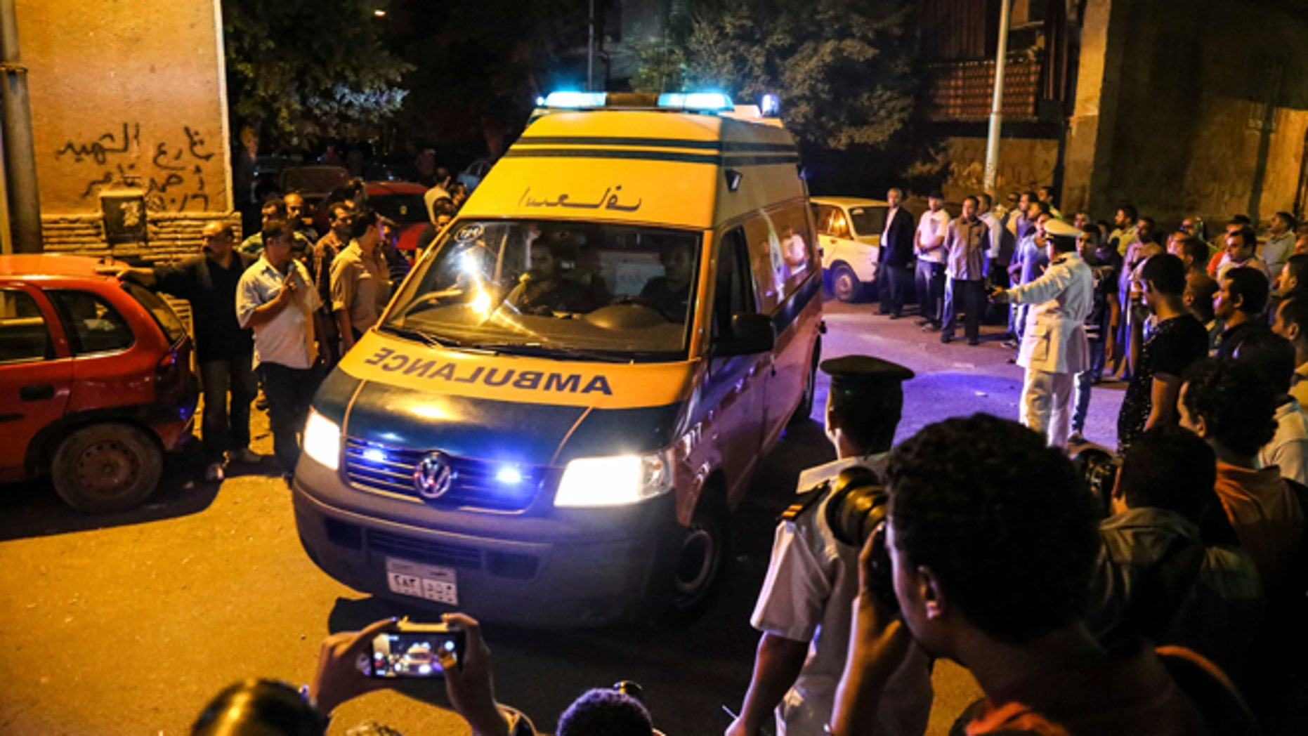 An ambulance carrying an Egyptian victim arrives at a morgue in Cairo, Egypt, Monday, Sept. 14, 2015.