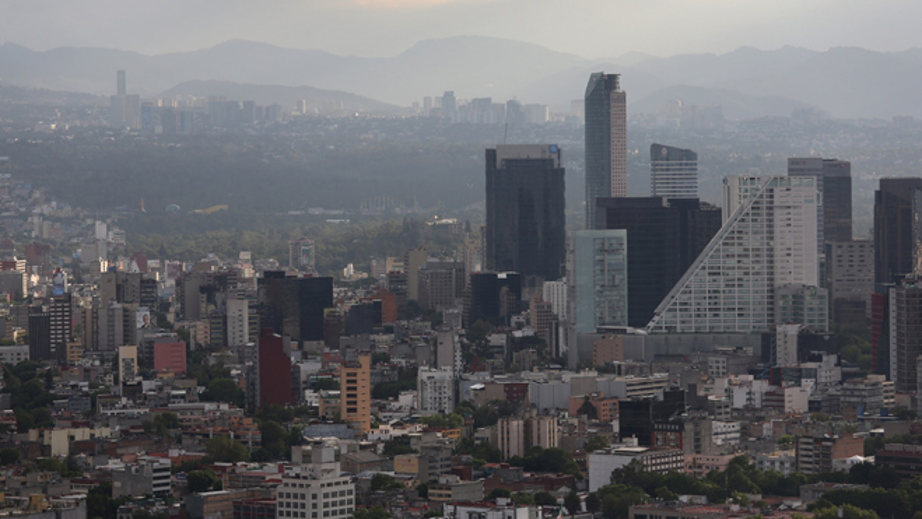 MEXICO CITY, MEXICO - JUNE 26:  A Mexico City skyline is seen through the haze from the Latino Tower on June 26, 2012 in Mexico City, Mexico. Mexicans go to the polls to elect a new president this Sunday, July 1.  (Photo by John Moore/Getty Images)