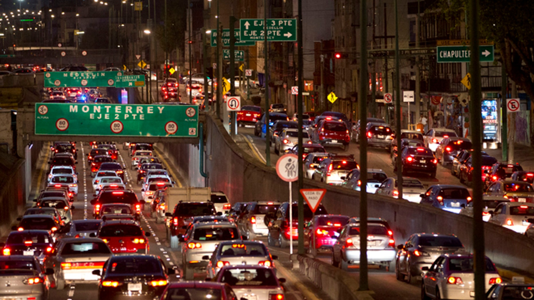 Cars sit in evening rush hour traffic in Mexico City, Wednesday, March 30, 2016. Metropolitan authorities on Wednesday temporarily ordered all cars to remain idle one day a week in response to this notoriously smoggy capital's worst air-quality crisis in over a decade. (AP Photo/Rebecca Blackwell)