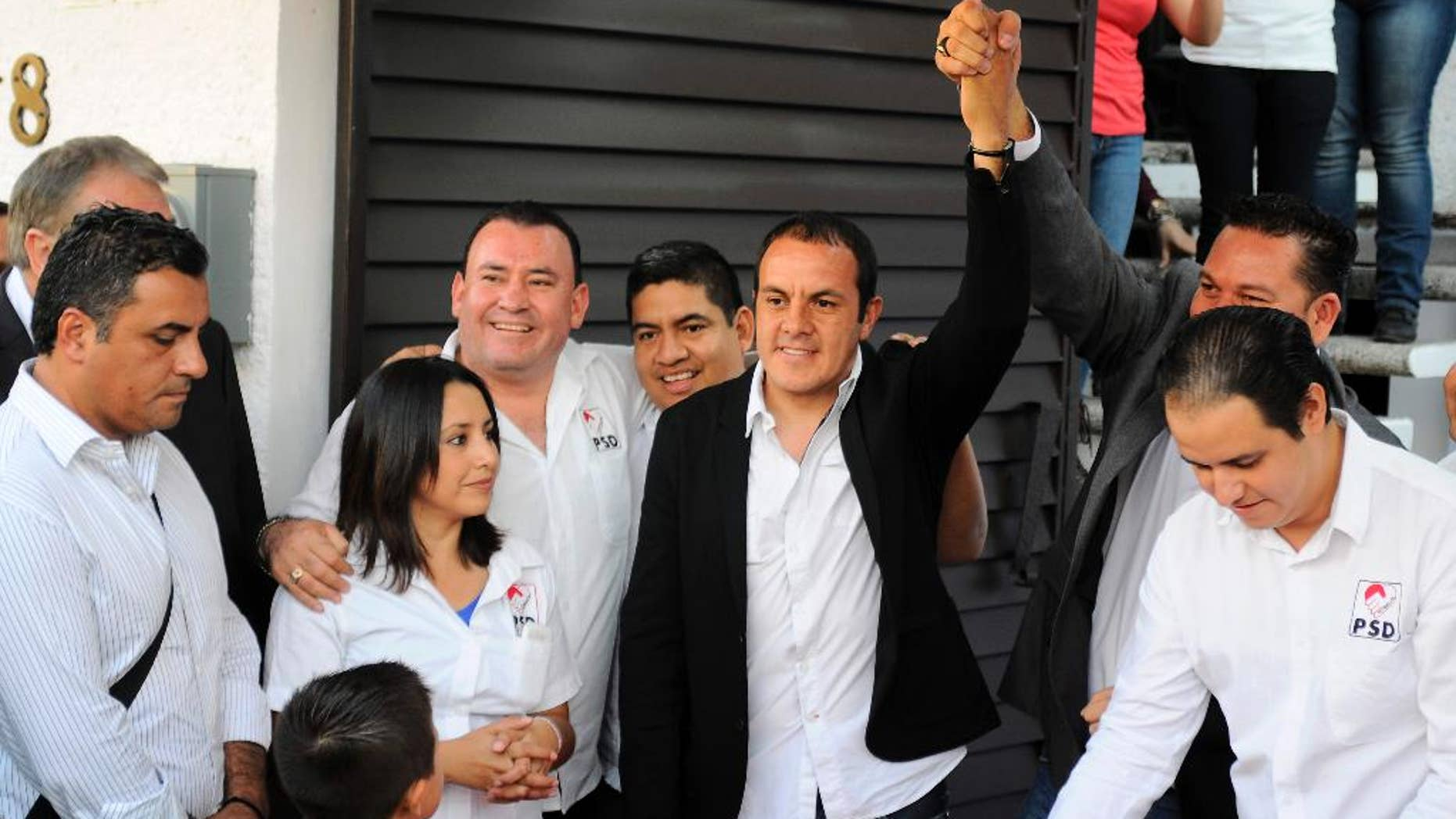 FILE - In this Jan. 22, 2015 file photo, professional soccer player Cuauhtemoc Blanco raises his arm after pre-registering to run for mayor in Cuernavaca, Mexico. (AP Photo/Tony Rivera, File)
