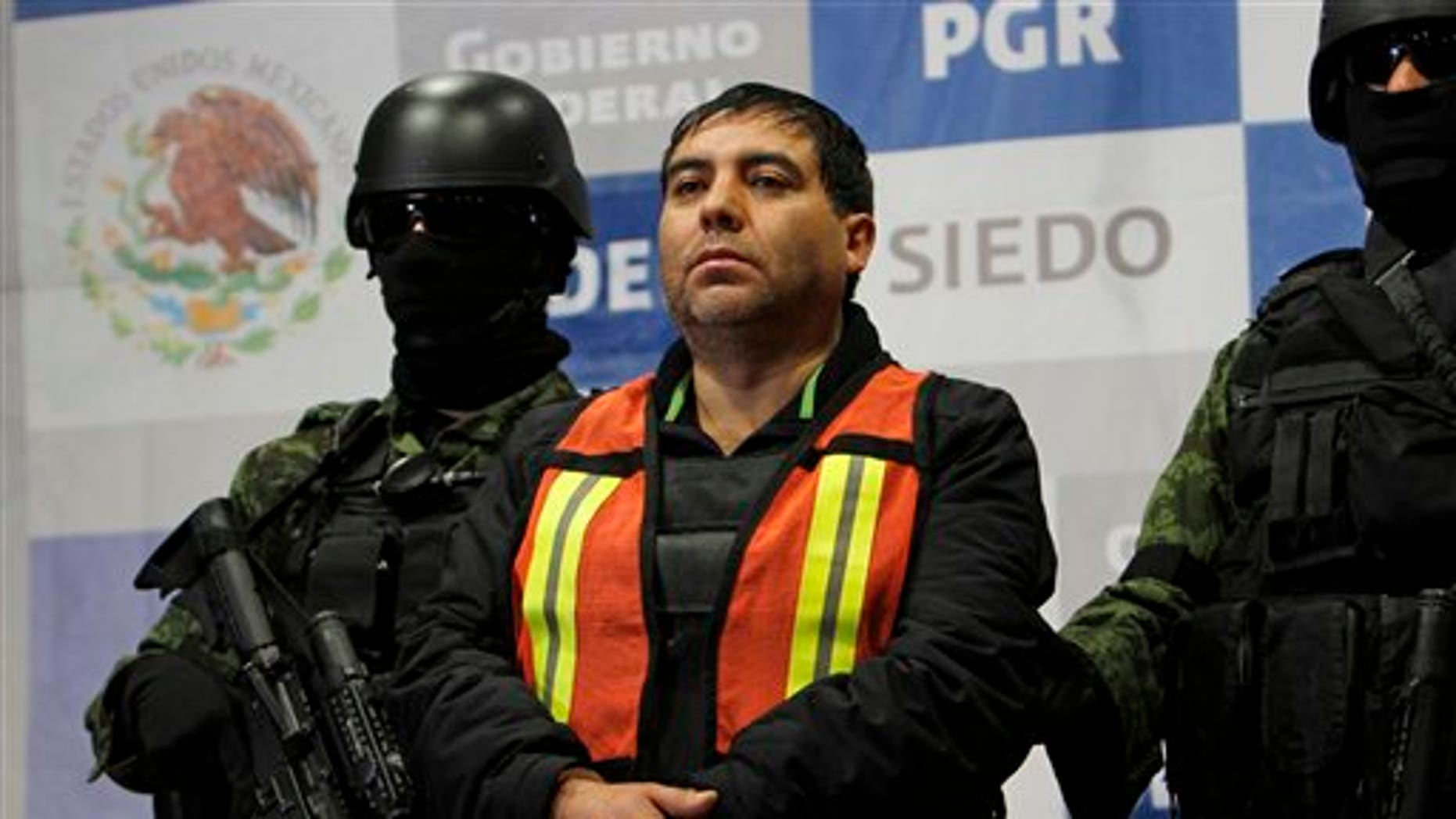Dec. 26: Felipe Cabrera Sarabia, alias 'El Inge' is shown to the press under the custody of army soldiers at the federal organized crime investigations headquarters in Mexico City.