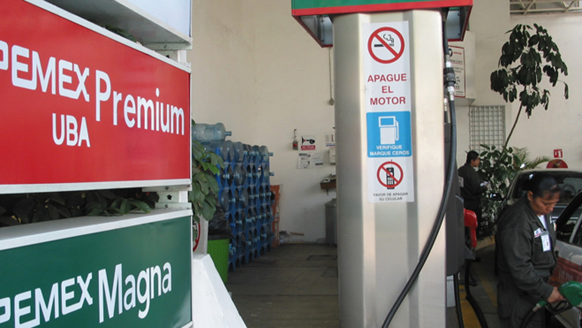 An attendant at a Mexico City gas station fills up a car on July 28, 2008. Mexican gas stations carry the Pemex name, but a lack of investment has left Mexico a net importer of gasoline. (Kevin G. Hall/MCT)