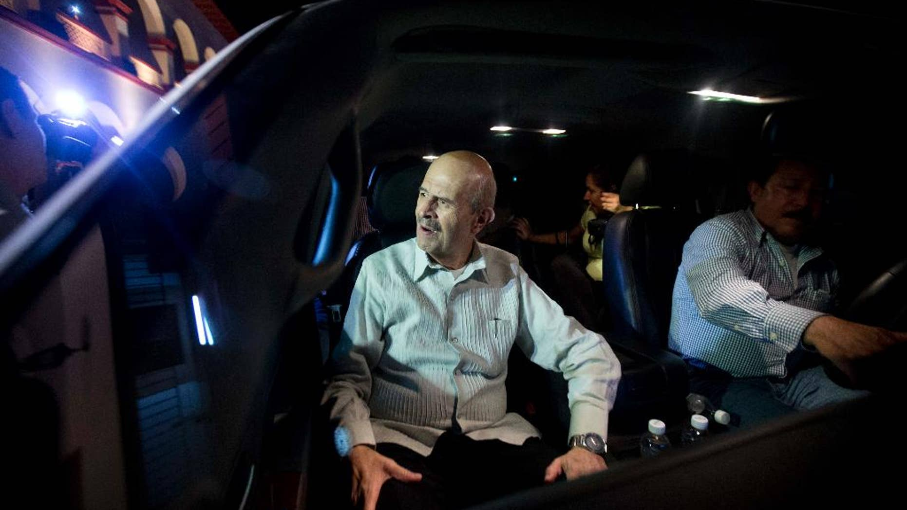 FILE - In this Jan. 14, 2014 file photo, Michoacan state Gov. Fausto Vallejo is driven away after attending a meeting at City Hall in Apatzingan, Mexico. Vallejo presented his resignation to Mexico's President Enrique Pena Nieto on Wednesday, June 18, 2014, citing health reasons. (AP Photo/Eduardo Verdugo, File)
