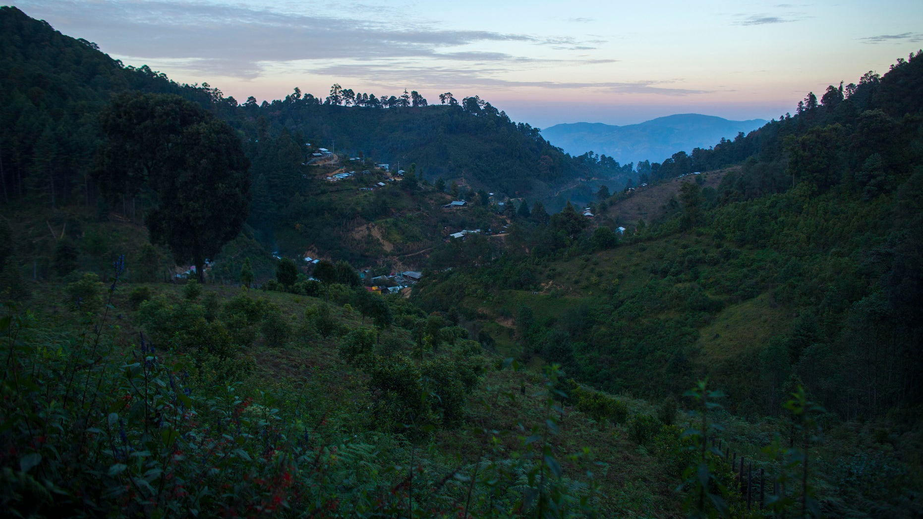 Homes dot the mountainside of the Sierra Madre del Sur where farmers grow poppy in Guerrero state, Mexico.