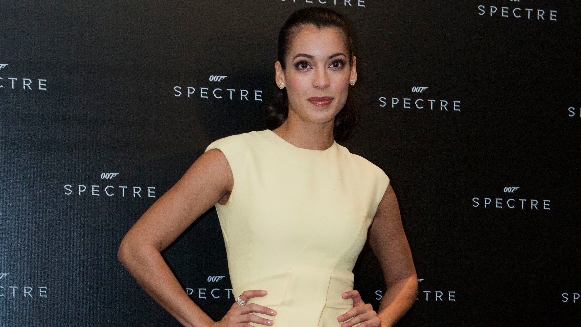 """FILE - In this March 18, 2015, file photo, """"Bond girl"""" Stephanie Sigman poses for pictures ahead of a press conference to discuss her role in the upcoming 007 film """"Spectre,"""" in Mexico City. Sigman, the first Mexican actress to play the role of a Bond girl in a film, will play the role of Estrella in the upcoming James Bond film âSpectre.â Sigman said Saturday, March 28, 2015, that having a tomboy attitude has helped her to play the role. (AP Photo/Rebecca Blackwell, File)"""