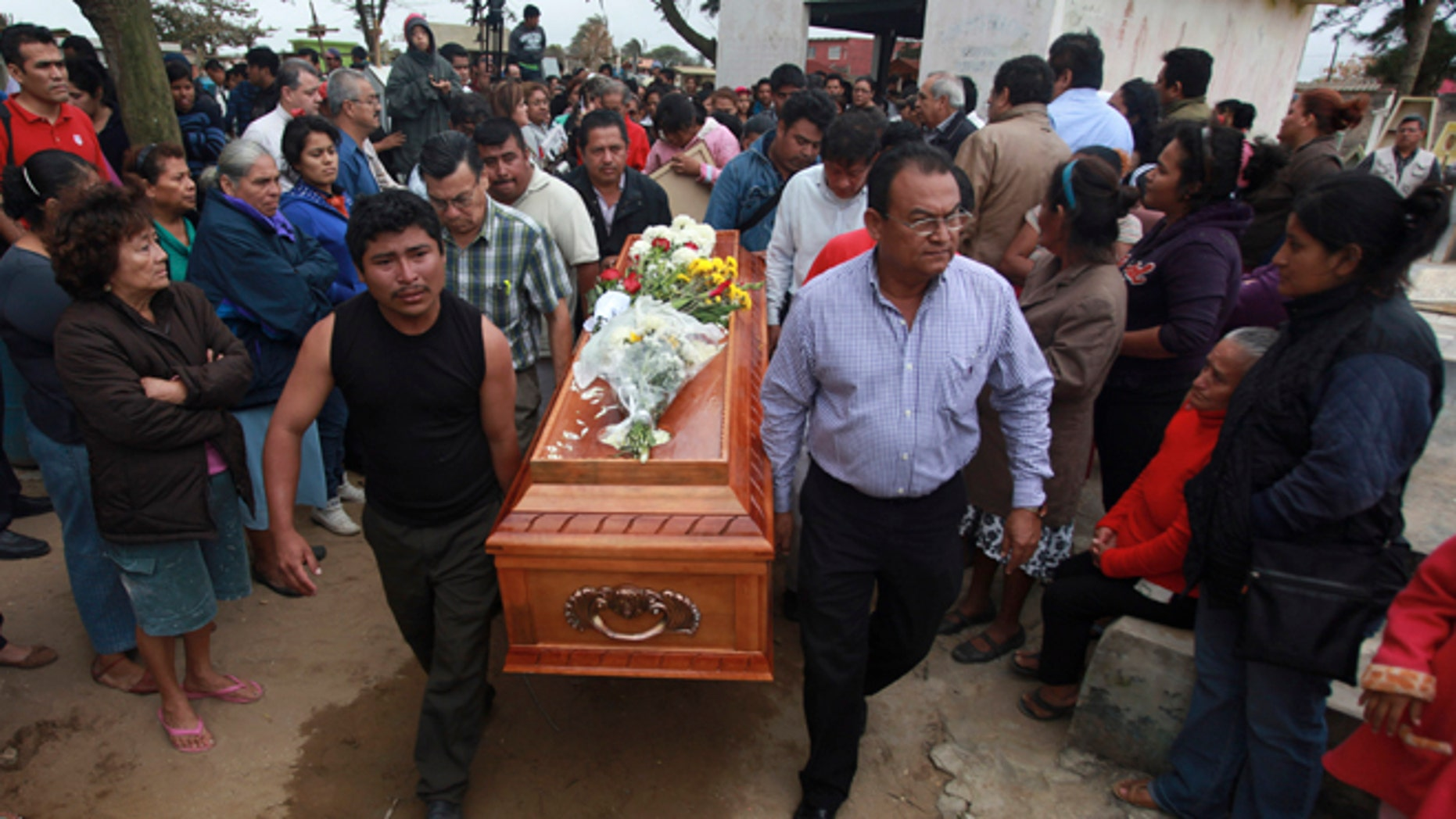Relatives carry the coffin that contain the remains of slain journalist Gregorio Jiménez as they walk towards the cemetery in Coatzacoalcos, Mexico, Wednesday, Feb. 12, 2014. Veracruz state officials concluded that Jiménez, a police beat reporter, was killed in a personal vendetta, unrelated to his reporting. But journalists throughout Mexico are calling for a thorough investigation. Jimenez is the 12th journalist slain or gone missing since 2010 in the Gulf state of Veracruz. (AP Photo/Felix Marquez)
