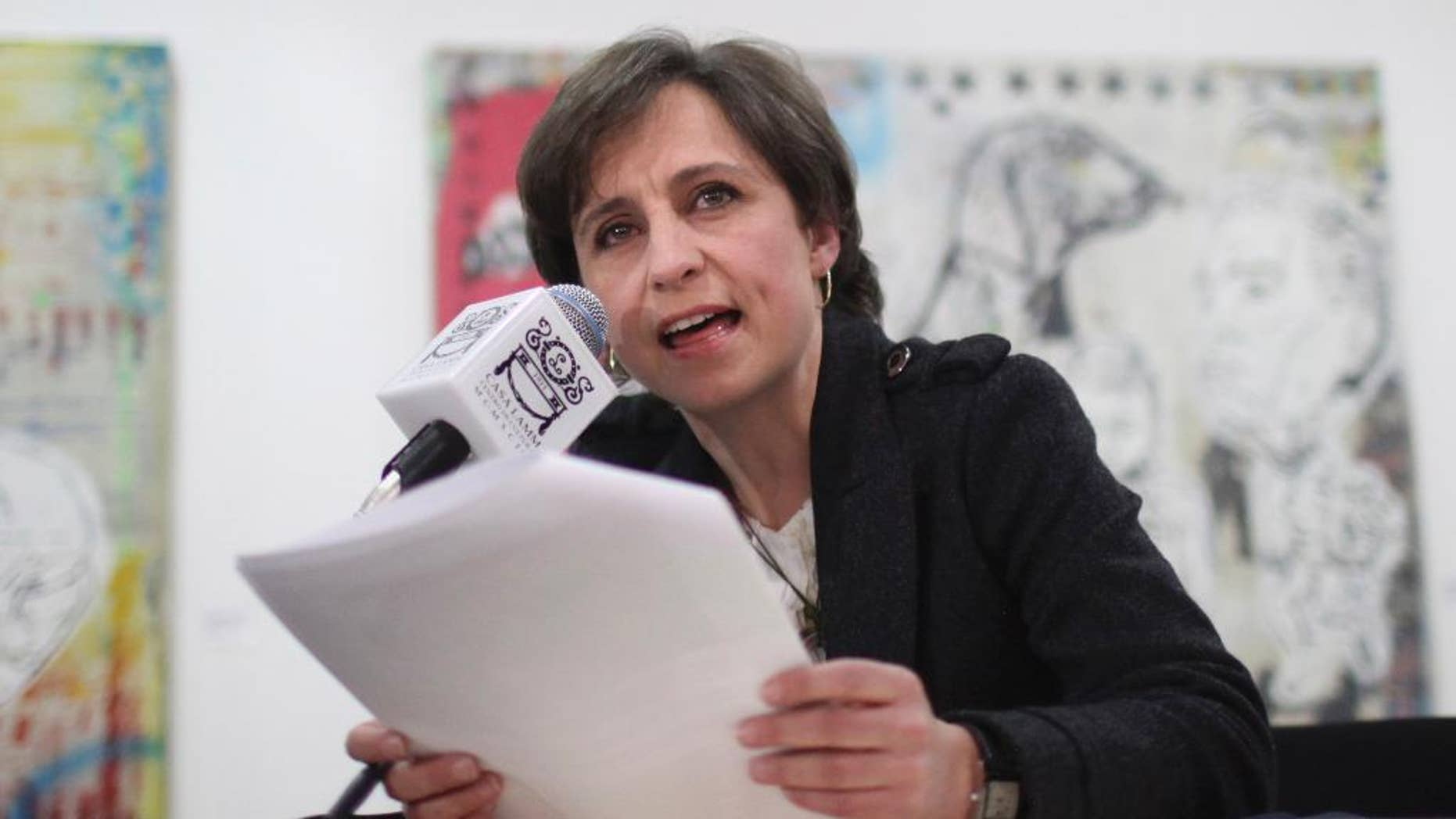 FILE - In this Feb. 9, 2011 file photo, Mexican journalist Carmen Aristegui gives a press conference in Mexico City. MVS Radio says Aristegui was fired on Sunday, March 15, 2015 for challenging the firing of reporters who had misused the company's name by linking it to a website meant to collect leaks of government information. But defenders of Aristegui note that the firing comes a few months after the same reporters had embarrassed President Enrique Pena Nieto by revealing his wife had a house financed by a frequent government contractor. (AP Photo/Alexandre Meneghini, File)