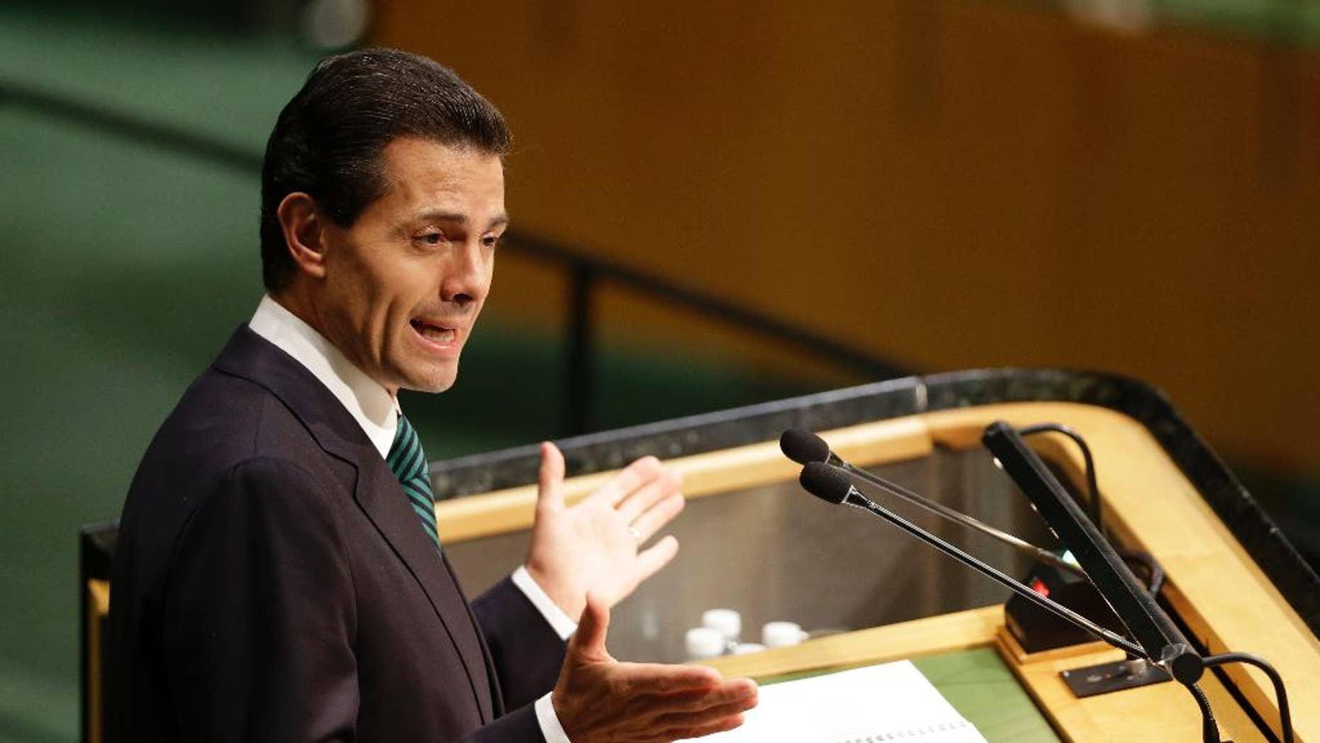FILE - In this Sept. 27, 2015, file photo, Mexican President Enrique Pena Nieto addresses the 2015 Sustainable Development Summit, at United Nations headquarters. Pena Nieto said Monday, Nov. 9, 2015, that he opposes any eventual legalization of marijuana, five days after the Supreme Court ruled in favor of four people who wanted to grow pot for personal use.(AP Photo/Seth Wenig, File)