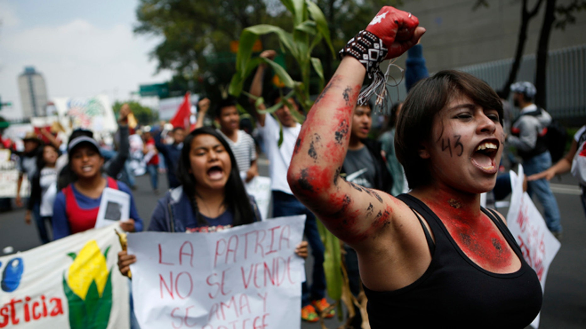 Protestors chant during a march commemorating the anniversary of the Tlatelolco Massacre, in Mexico City, Sunday, Oct. 2, 2016. Every year Mexico marks the anniversary of the 1968 massacre where students and civilians were killed by the military and police.(AP Photo/Rebecca Blackwell)