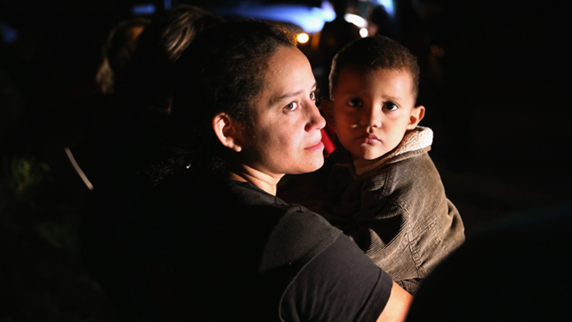 MISSION, TX - SEPTEMBER 08:  Families of Central American immigrants, including Jamie Gonzales, 26, and her son Jose Manuel, 4, from El Salvador, turn themselves in to U.S. Border Patrol agents after crossing the Rio Grande River from Mexico on September 8, 2014 to Mission, Texas. Although the numbers of such immigrant families and unaccompanied minors have decreased from a springtime high, thousands continue to cross in the border illegally into the United States. The Rio Grande Valley sector is the busiest area for illegal border crossings, especially for Central Americans, into the U.S.  (Photo by John Moore/Getty Images)