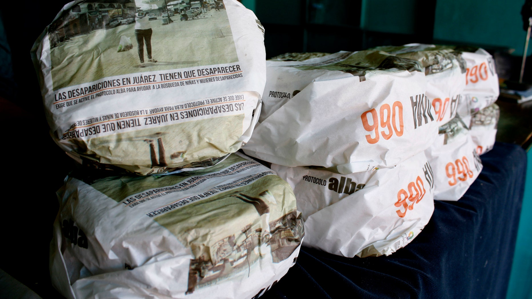One kilogram packages of corn tortillas, packaged with advertisements asking for help to find missing women and children, sit for sale at the Hermanos Escobar Tortilla shop in the northern border city of Ciudad Juarez, Mexico.