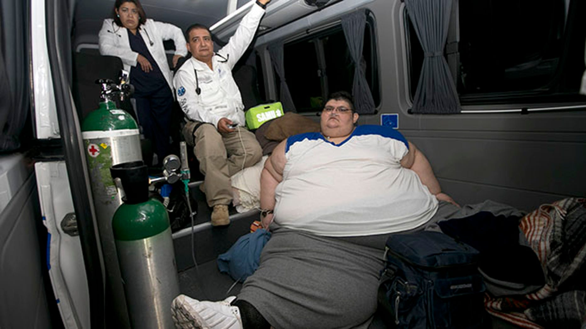 Juan Pedro is taken care of by paramedics on arrival at hospital in Guadalajara, Mexico, Tuesday, Nov. 15, 2016. Juan Pedro,who weighs about 1,100 pounds (500 kilos) and hasn't left his bed in six years has been removed by medical personnel for treatment. His doctor gave the man's name only as Juan Pedro, 32, from the central city of Aguascalientes. (AP Photo/Refugio Ruiz)